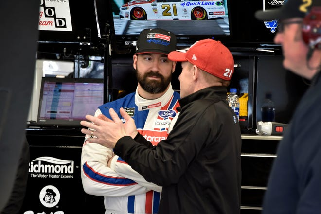 Driver Paul Menard and crew chief Greg Erwin confer during the NASCAR test Jan. 31 at Las Vegas Motor Speedway.