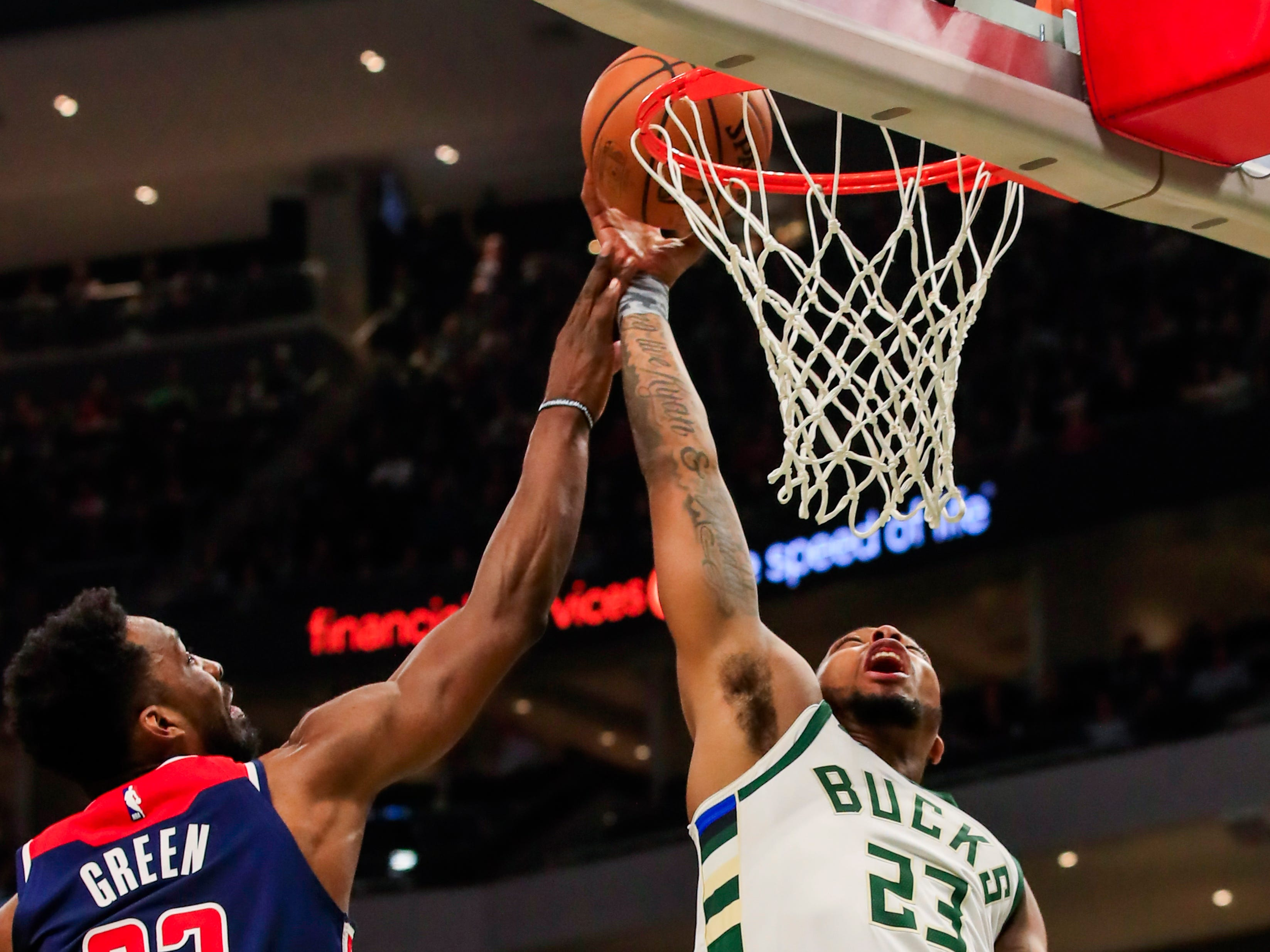 Bucks guard Sterling Brown scores against Wizards forward Jeff Green on Wednesday night.