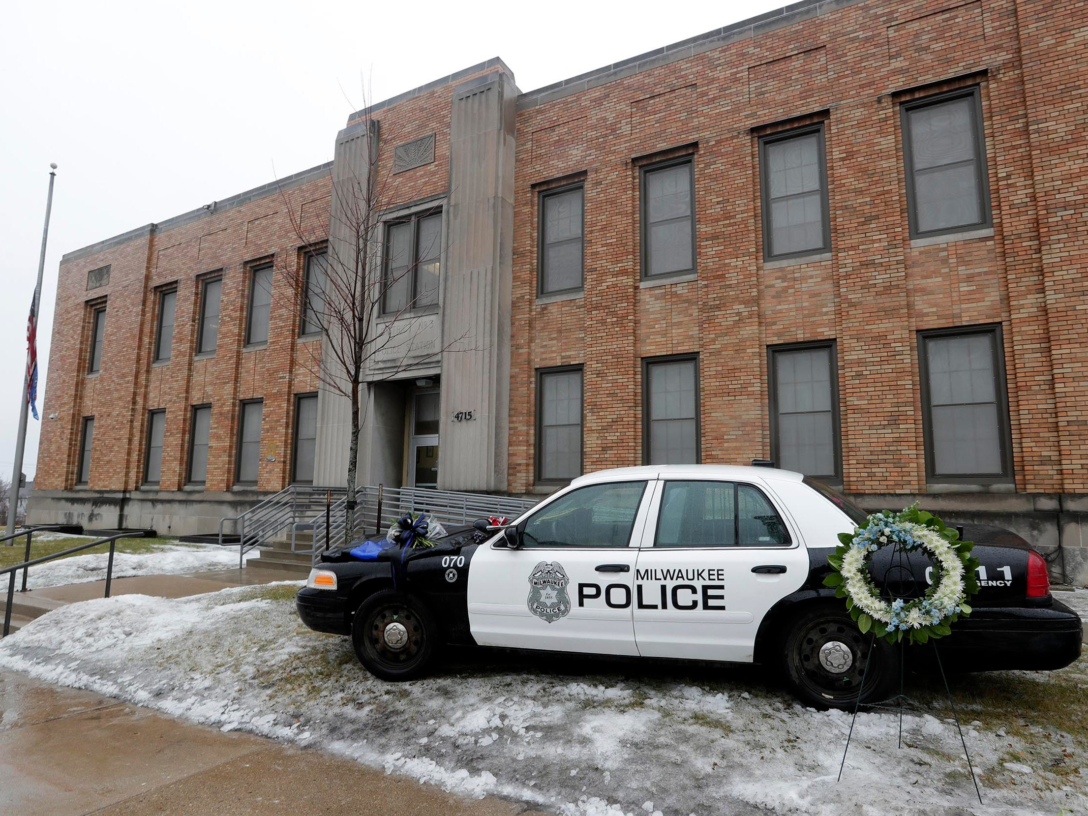 The Milwaukee Police Department building at 4715 W. Vliet St. has a memorial with a bouquet of flowers and other items to honor Officer  Matthew Rittner, a 17-year department veteran, who was killed Wednesday when a team of officers tried to serve a search warrant related to an investigation of illegal gun and drug sales.