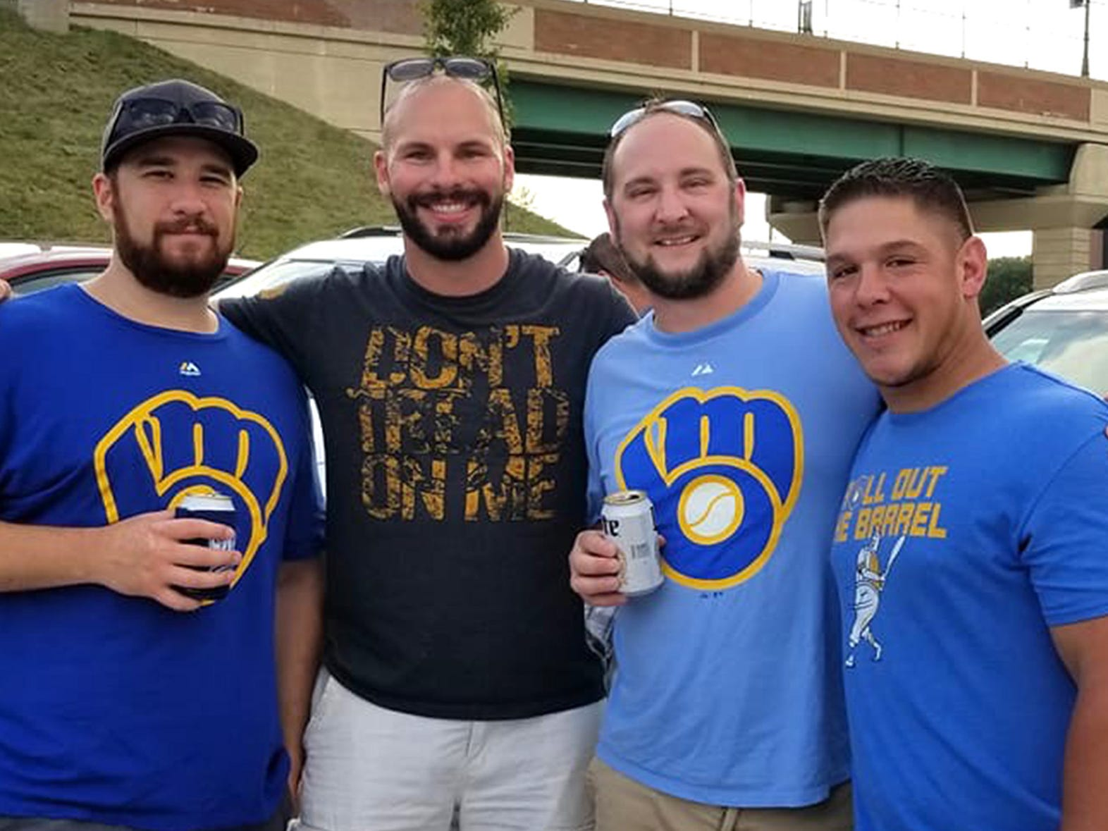 Matthew Rittner (right) attends a Brewers game last fall with fellow U.S. Marine veterans (from left) Frank Galindo, Max Zaruba and Bob Knoll.