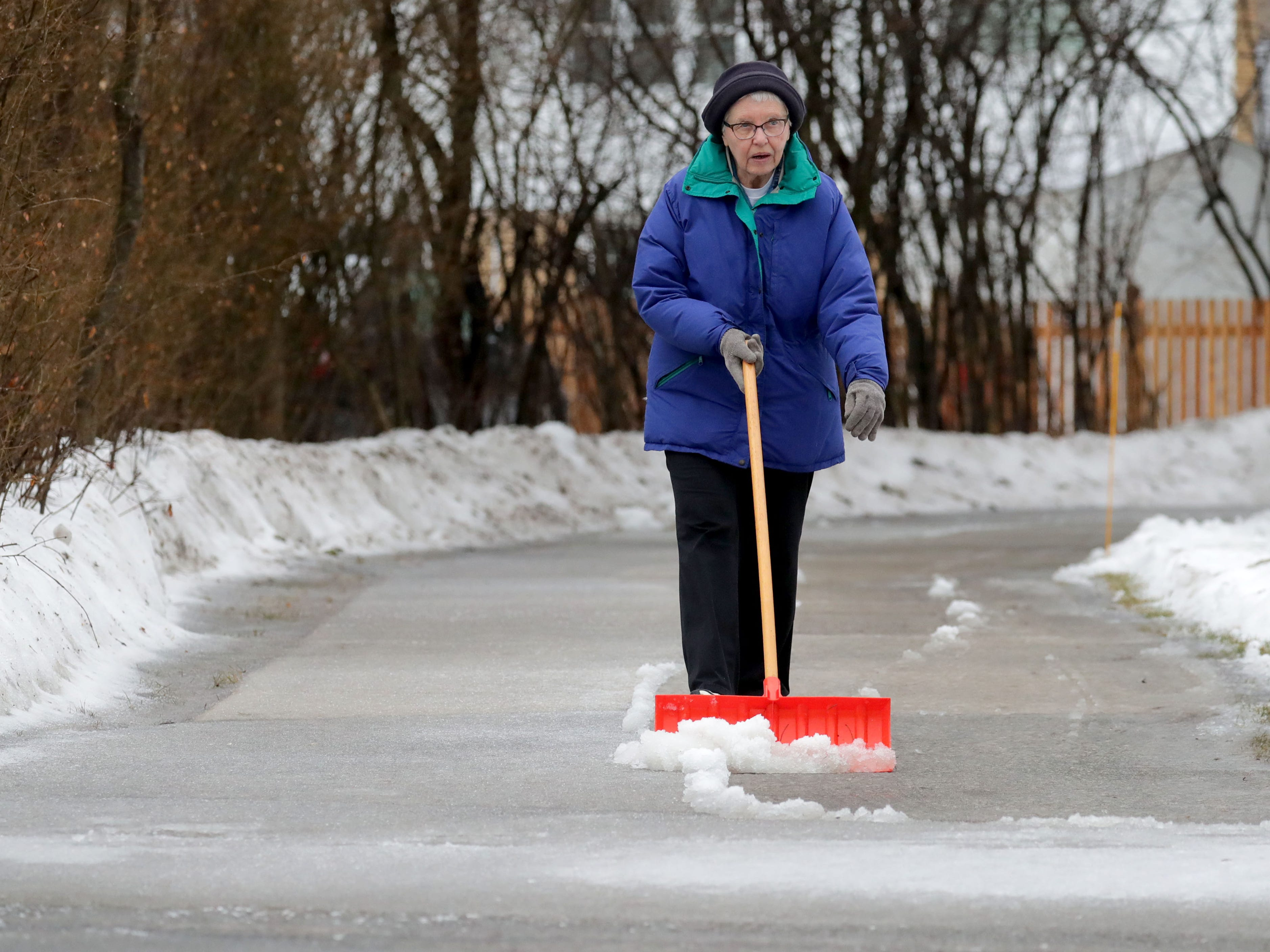 A woman, who wished to remain unidentified, shovels the ice on her drive on Lake Drive in Fox Point on Wednesday, Feb. 6, 2019. While freezing rain made roads and sidewalks a slushy mess Wednesday, the Milwaukee metro area is in for another round of icy weather that is expected to make the commutes hazardous Wednesday night and Thursday morning. A winter weather advisory for Ozaukee and Washington counties as well as the Madison area has been issued for 6 p.m. Wednesday to 6 p.m Thursday. Total snow accumulations of up to 2 inches and ice accumulations of two-tenths to three-tenths of an inch are expected.