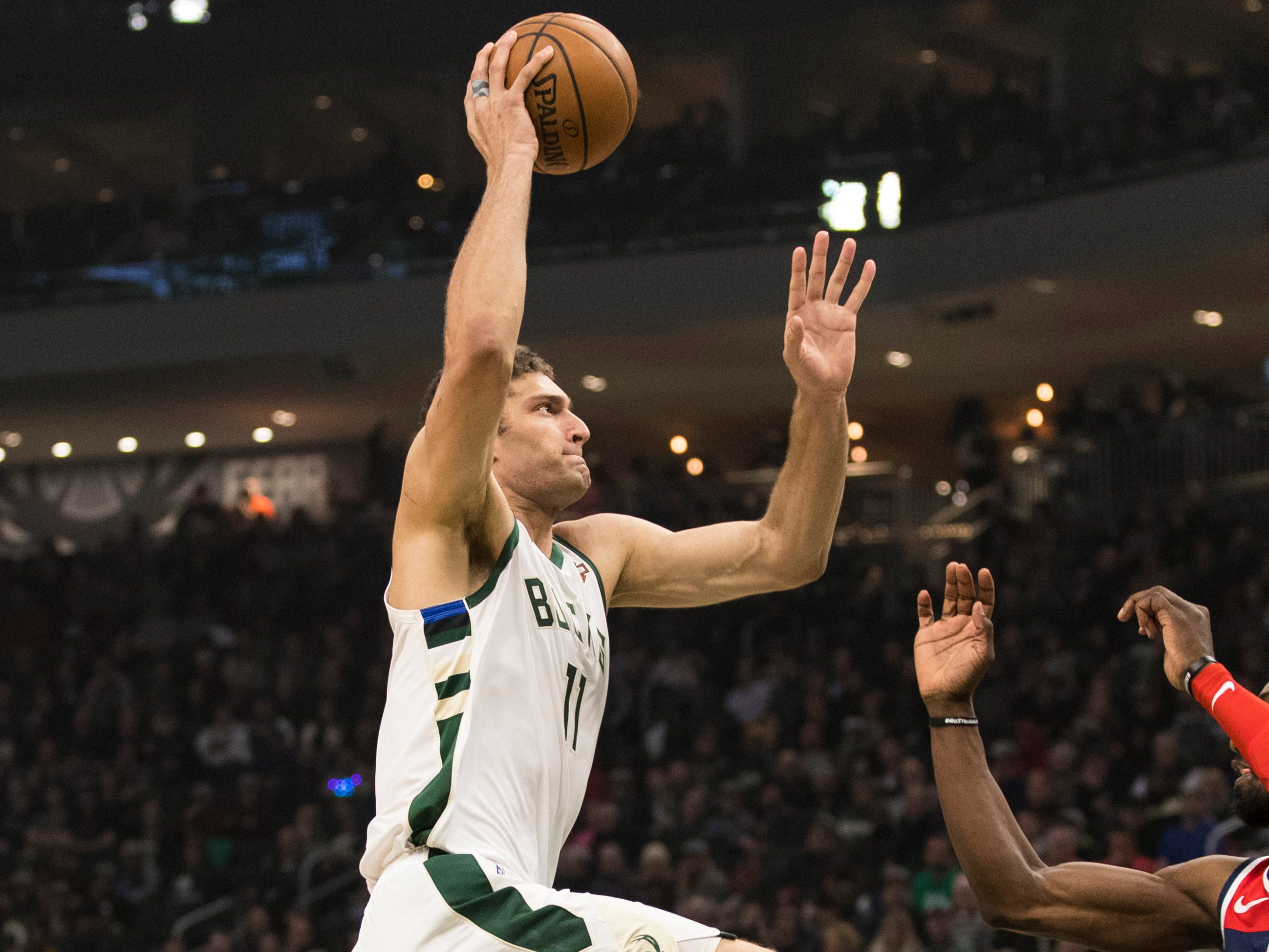 Bucks center Brook Lopez gets ready for liftoff as he prepares to slam home two points against the Wizards on Wednesday night.