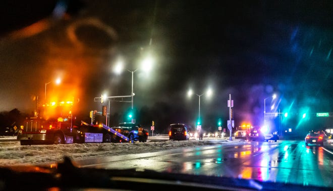 City of Pewaukee police respond to an accident at the intersection of West Blue Mound Road and Springdale Road Wednesday evening. Freezing rain and icy roads throughout southeast Wisconsin made travel extremely hazardous.