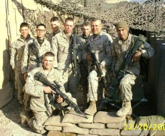 Matthew Rittner (far left) in Iraq in 2004.