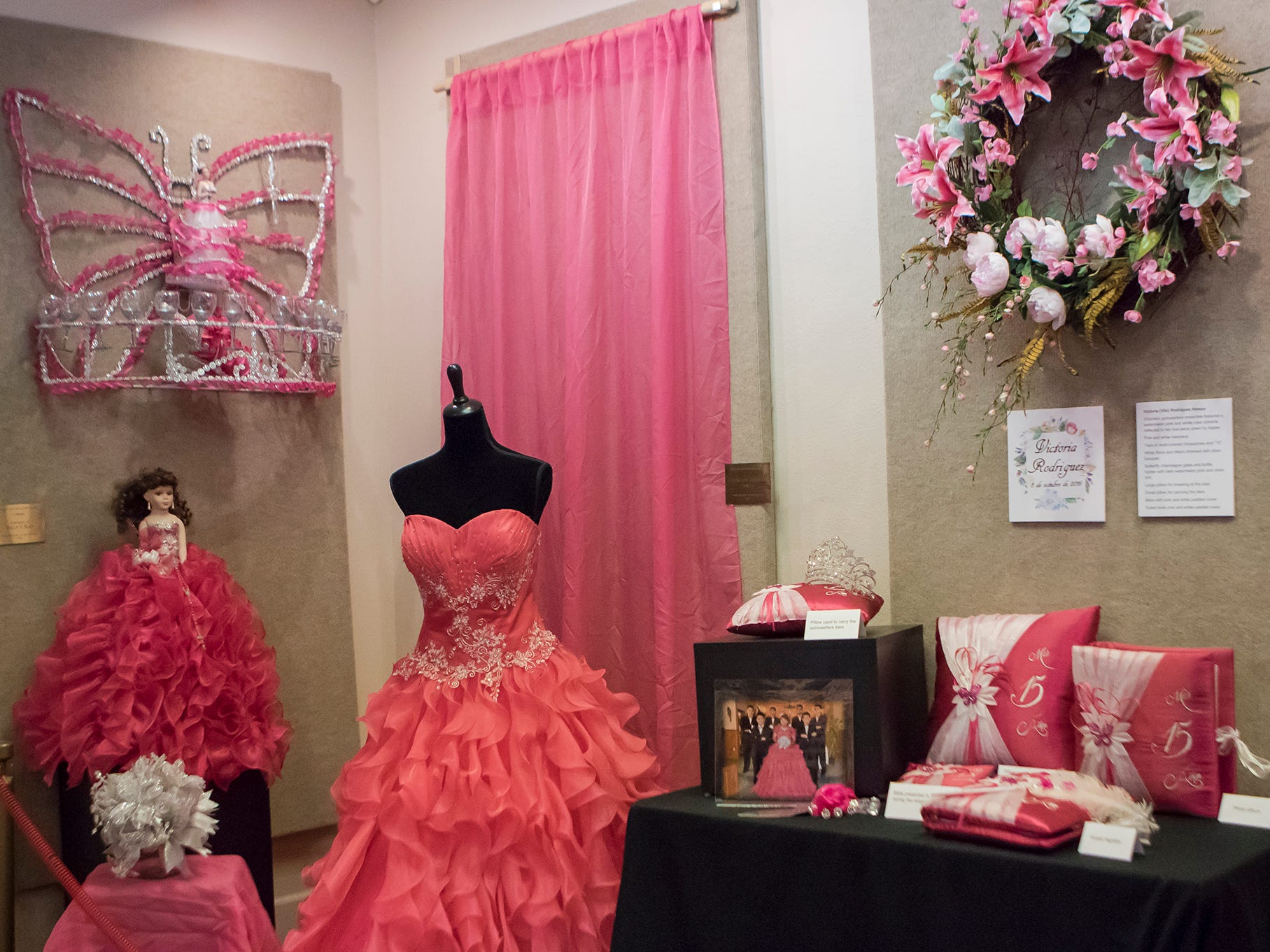 Victoria Rodriguez's quinceañera dress and accessories sit on display at the Union Museum of History and Art in Farmerville, La. as part of an exhibit highlighting Hispanic culture in Union Parish on Feb. 7. Quinceañeras are traditional celebrations for 15 year old girls to signify their transition into womanhood.