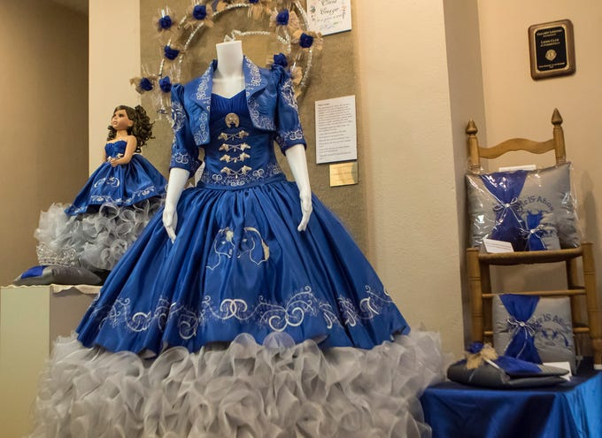 Olivia Creager's quinceañera dress and accessories sit on display at the Union Museum of History and Art in Farmerville, La. as part of an exhibit highlighting Hispanic culture in Union Parish on Feb. 7. Quinceañeras are traditional celebrations for 15 year old girls to signify their transition into womanhood.