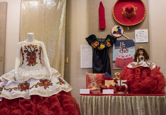 Maria Gonzalez's quinceañera dress and accessories sit on display at the Union Museum of History and Art in Farmerville, La. as part of an exhibit highlighting Hispanic culture in Union Parish on Feb. 7. Quinceañeras are traditional celebrations for 15 year old girls to signify their transition into womanhood.
