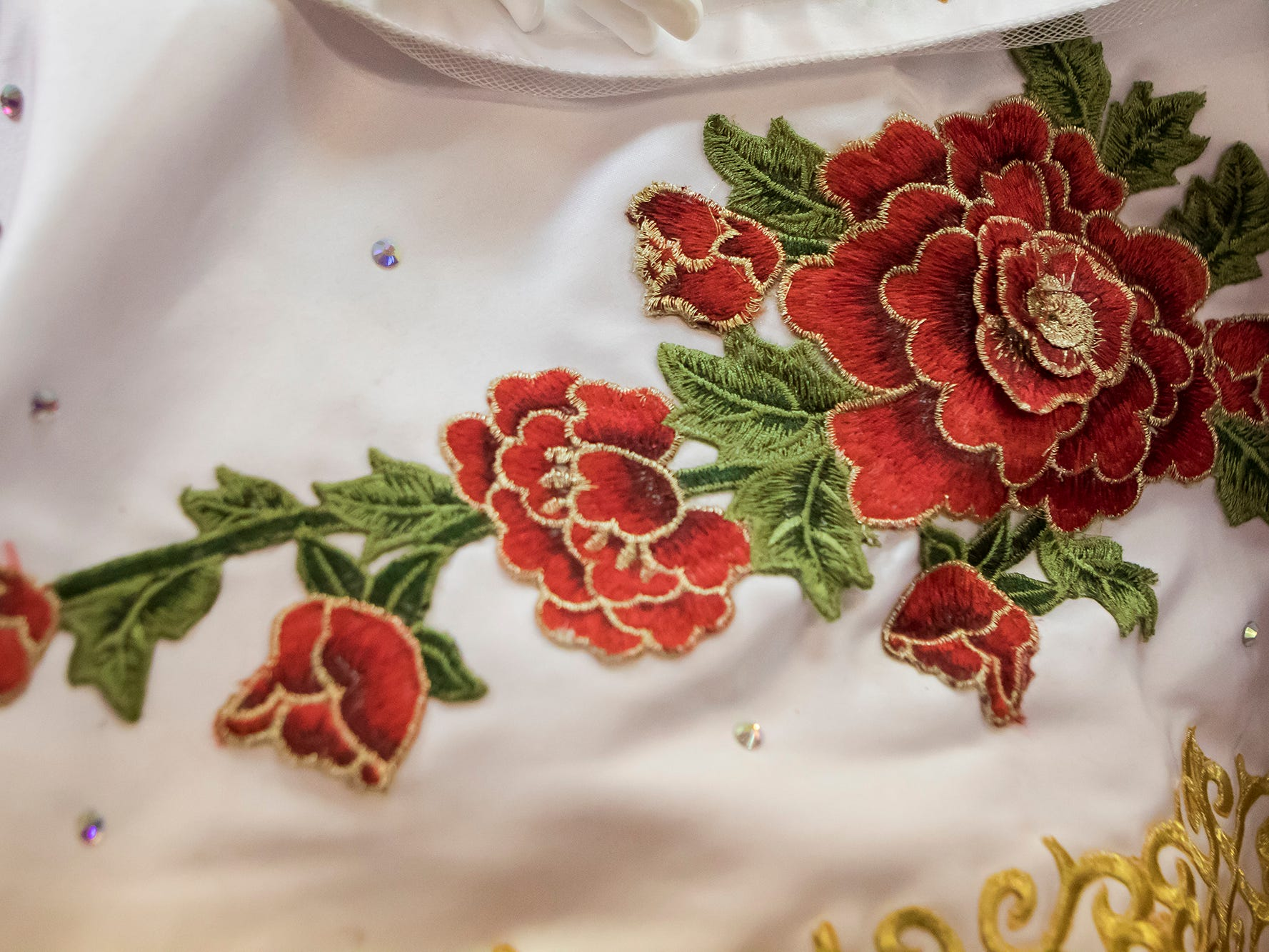 Detail of one of the stitched floral pieces on Maria Gonzalez's quinceañera dress, which is on display at the Union Museum of History and Art in Farmerville, La. as part of an exhibit highlighting Hispanic culture in Union Parish on Feb. 7. Quinceañeras are traditional celebrations for 15 year old girls to signify their transition into womanhood.