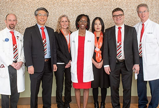 A team including From left are: Dr. Timothy Pardee, professor of cancer biology Wei Zhang, research assistant Elizabeth Forbes, Dr. Zanetta Lamar, research fellow Qianqian Song, Dr. Boris Pasche and  Dr. Bayard Powell.