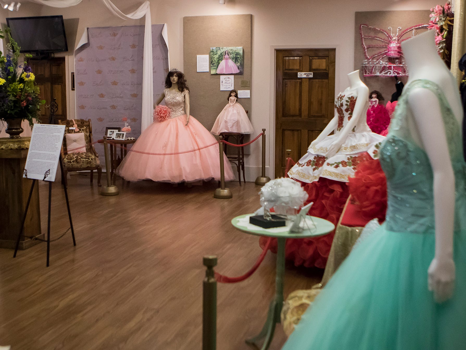 Quinceañera dresses and accessories from local Farmerville, La. girls sit on display at the Union Museum of History and Art in Farmerville, La. as part of an exhibit highlighting Hispanic culture in Union Parish on Feb. 7. Quinceañeras are traditional celebrations for 15 year old girls to signify their transition into womanhood.