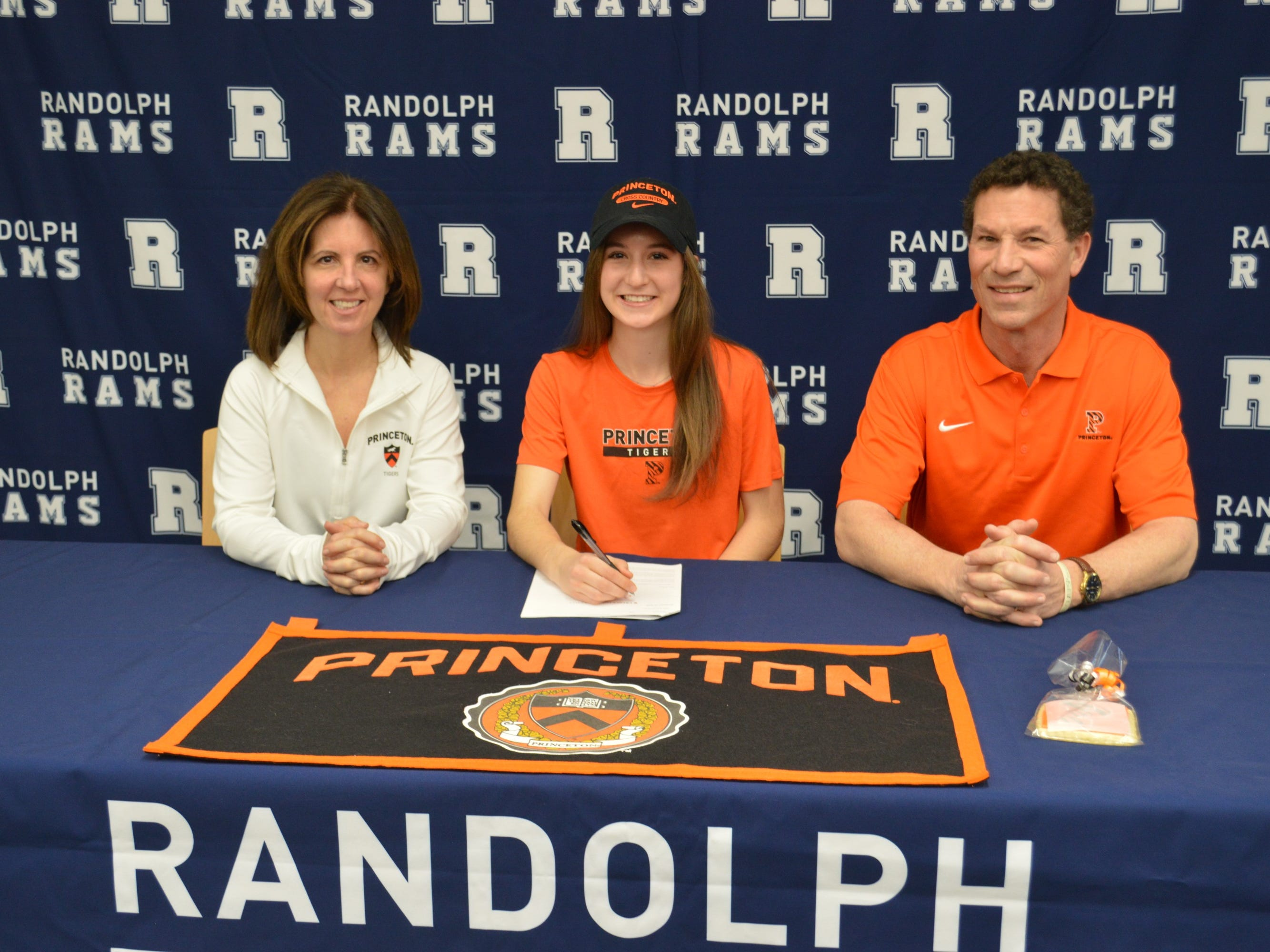 Randolph distance runner Abby Loveys plans to continue her academic and athletic career at Princeton. She committed with her parents, Karen and Randolph mayor Jim Loveys.