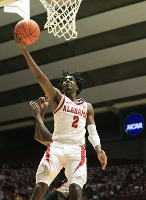 Feb 6, 2019; Tuscaloosa, AL, USA; Alabama Crimson Tide guard Kira Lewis Jr. (2) goes to the basket against Georgia Bulldogs during the second half at Coleman Coliseum. Mandatory Credit: Marvin Gentry-USA TODAY Sports