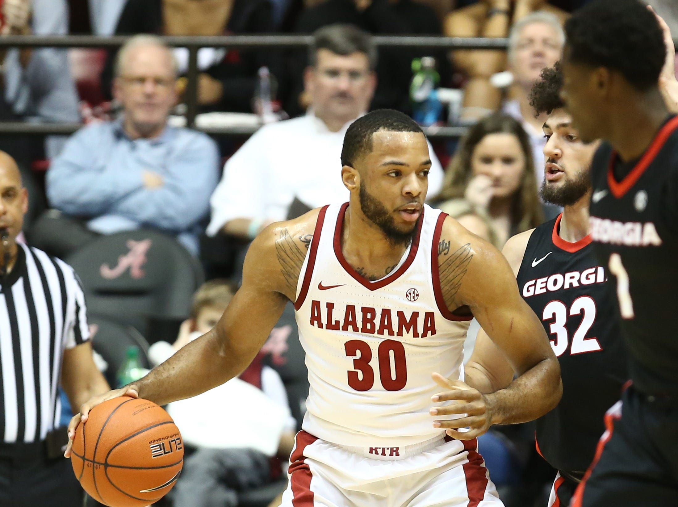 Feb 6, 2019; Tuscaloosa, AL, USA; Alabama Crimson Tide forward Galin Smith (30) drives to the basket against  during the first half Georgia Bulldogs at Coleman Coliseum. Mandatory Credit: Marvin Gentry-USA TODAY Sports
