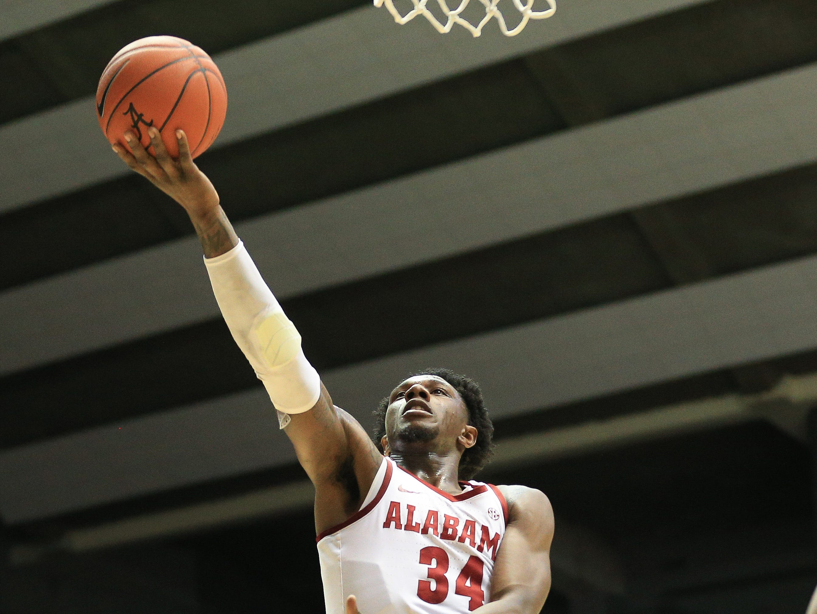 Feb 6, 2019; Tuscaloosa, AL, USA; Alabama Crimson Tide guard Tevin Mack (34) goes to the basket against Georgia Bulldogs during the second half at Coleman Coliseum. Mandatory Credit: Marvin Gentry-USA TODAY Sports