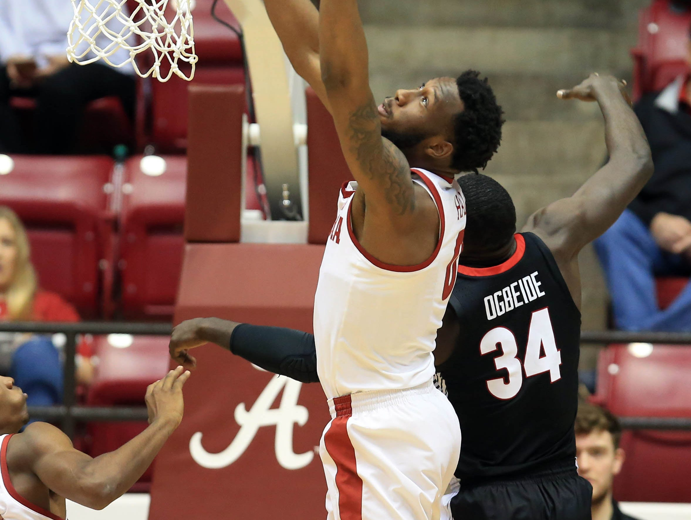 Feb 6, 2019; Tuscaloosa, AL, USA; Alabama Crimson Tide forward Donta Hall (0) grabs a rebound from Georgia Bulldogs forward Derek Ogbeide (34) during the second half at Coleman Coliseum. Mandatory Credit: Marvin Gentry-USA TODAY Sports