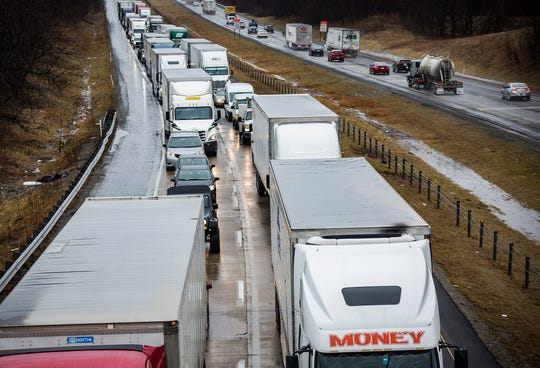 Traffic backs up during pothole repairs on Interstate 69 on Feb. 7.