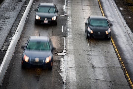 Traffic moves along I-69 Thursday afternoon. State police have urged drivers to slow down on the highway due to the prevalence of potholes.