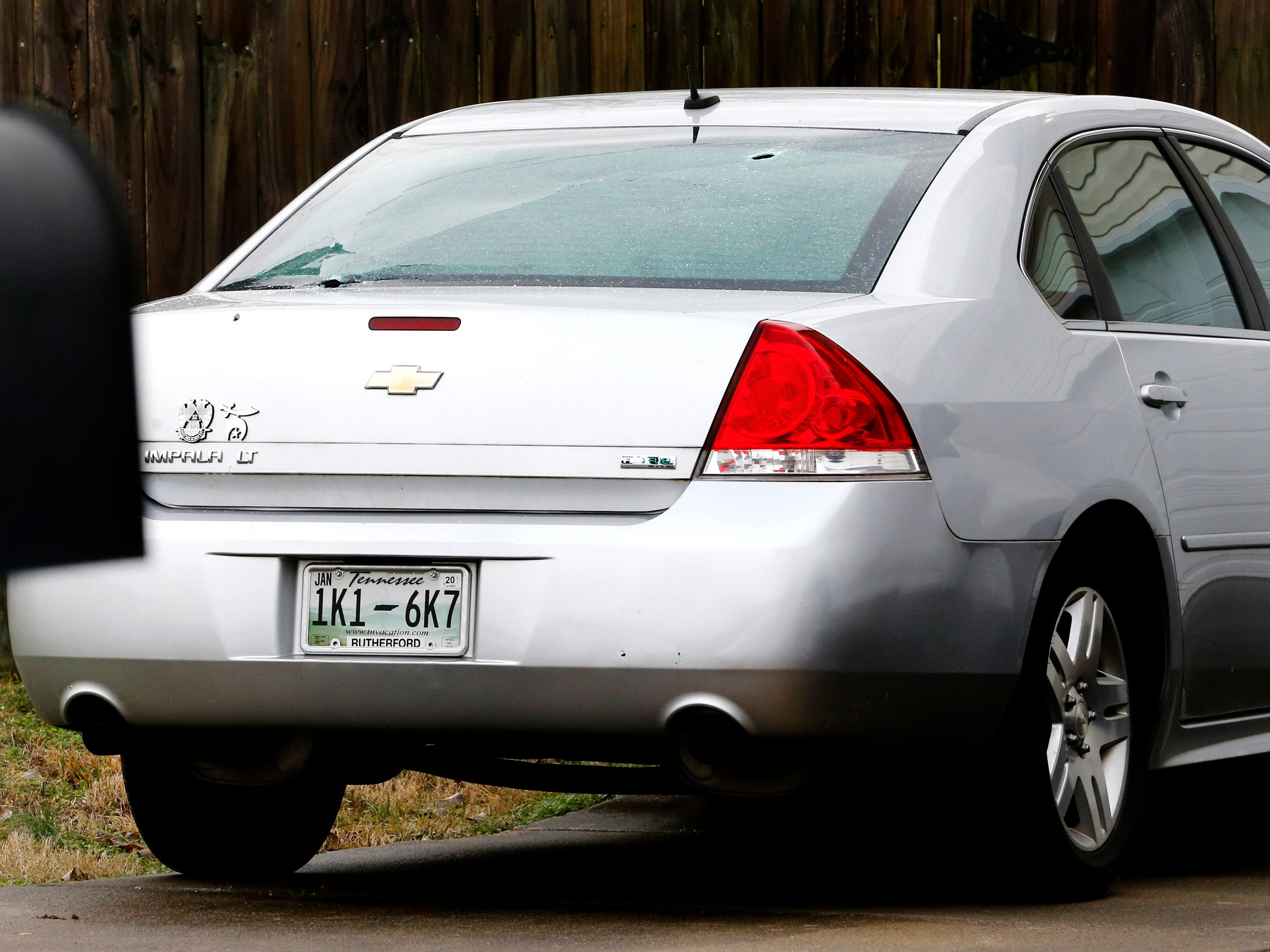 Bullet holes are seen in the back window of an Impala at a home on the 200 block of Breeze Drive, where an officer-involved deadly shooting took place on Thursday, Feb. 7, 2019.
