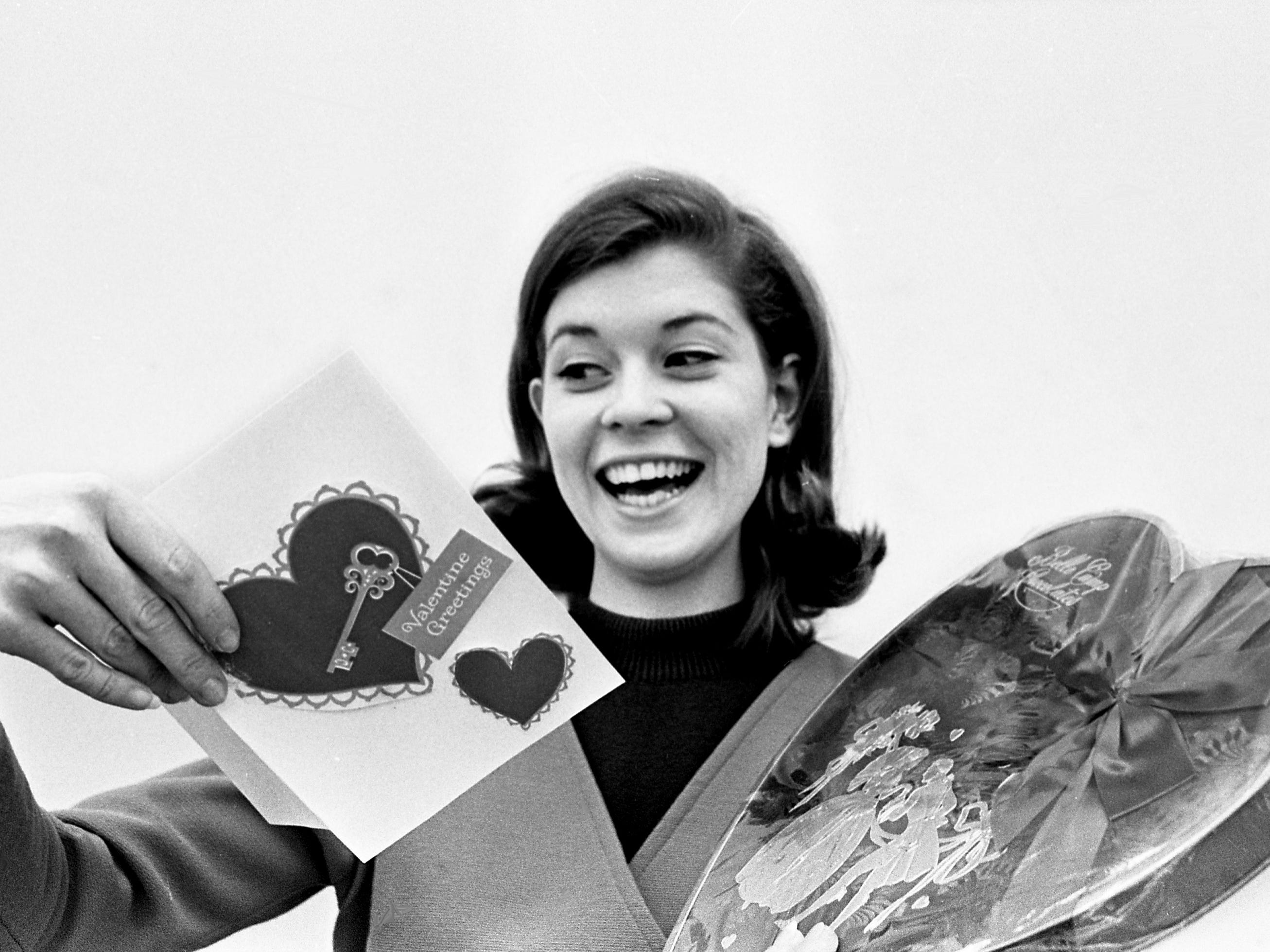 Miss Eileen Wilson of Chapel Hill, Tenn., is all smiles as she looks over requests from young men to be her valentine Feb. 13, 1968. She is one of the many ladies - both young and old - who will be receiving candy, flowers and cards the next day.