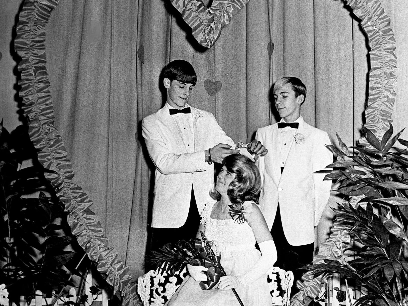David Fudge, left, crowns Valentine Queen Sharon Leonard during the annual Highland Heights Junior High School Valentine pageant Feb. 14, 1969. Freddie Freeman, right, is Sharon's escort.