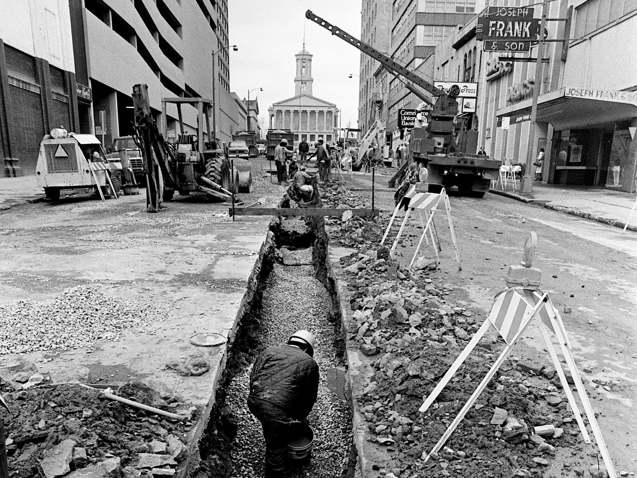 As preparations get underway for a major renovation of Capitol Boulevard, along the lines of reconstruction of Church Street, workers from the Metro waterworks department lay pipe through the center of the street Feb. 22, 1979.