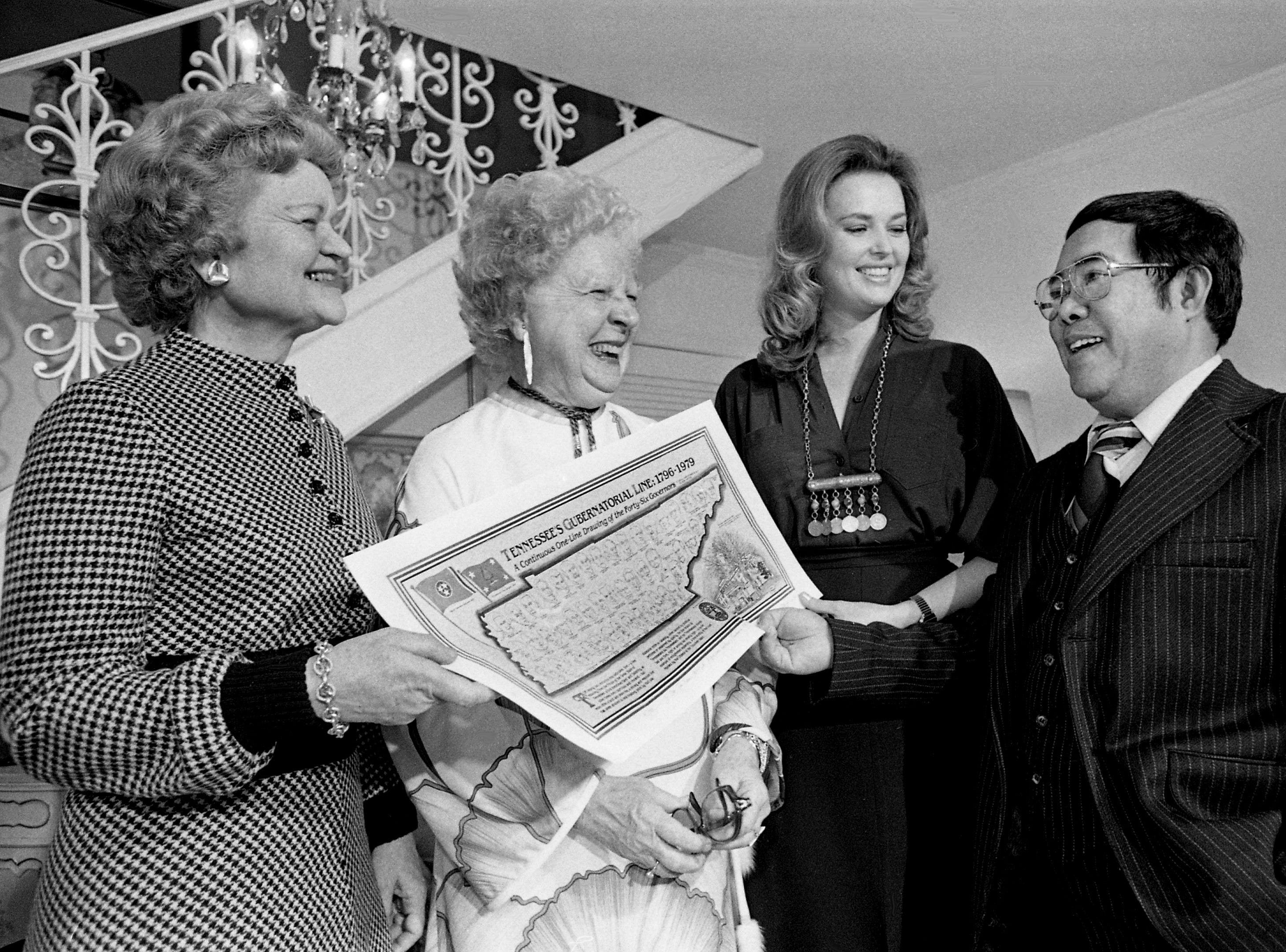 "Former Tennessee first ladies Mrs. Prentice Cooper, left, and Mrs. Jim Nance McCord and Mrs. Timothy Wagner (Ann Ellington), daughter of former Gov. Buford Ellington, receive ""pictographs"" from Nashville artist Dani Aguila as an early Valentine's Day gift Feb. 13, 1979. The pictographs were of all 46 state governors, from John Sevier to Lamar Alexander, drawn in one continuous, unbroken line."