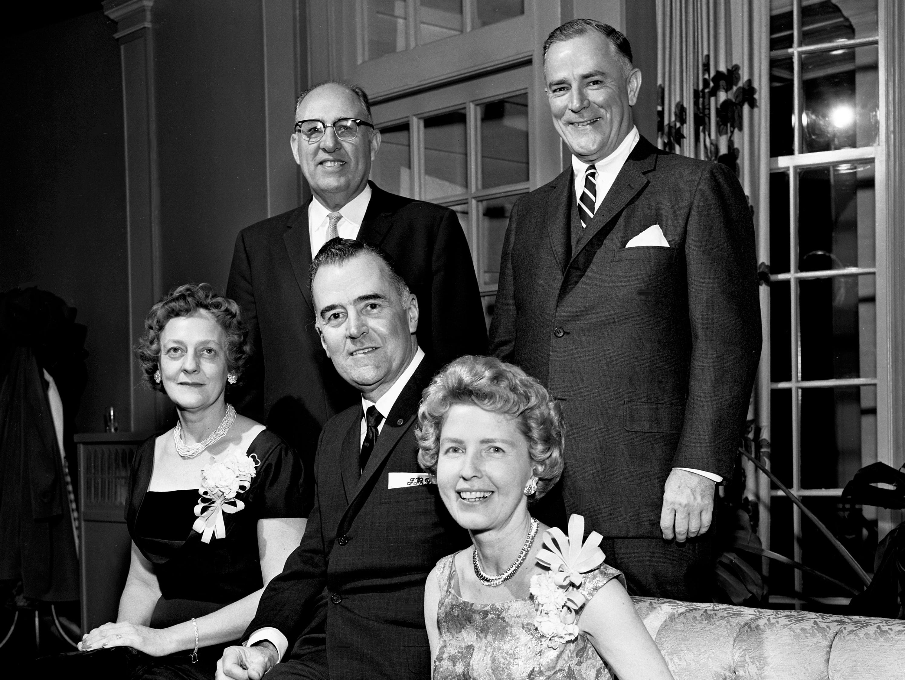 Members of the Rotary Club entertaining at a Valentine dinner and dance at Belle Meade Country Club on Feb. 14, 1961, are Mrs. P.D. Houston Jr., seated left, Mr. and Mrs. John Dubuisson, Wister Ligon, standing left, and P.D. Houston Jr.