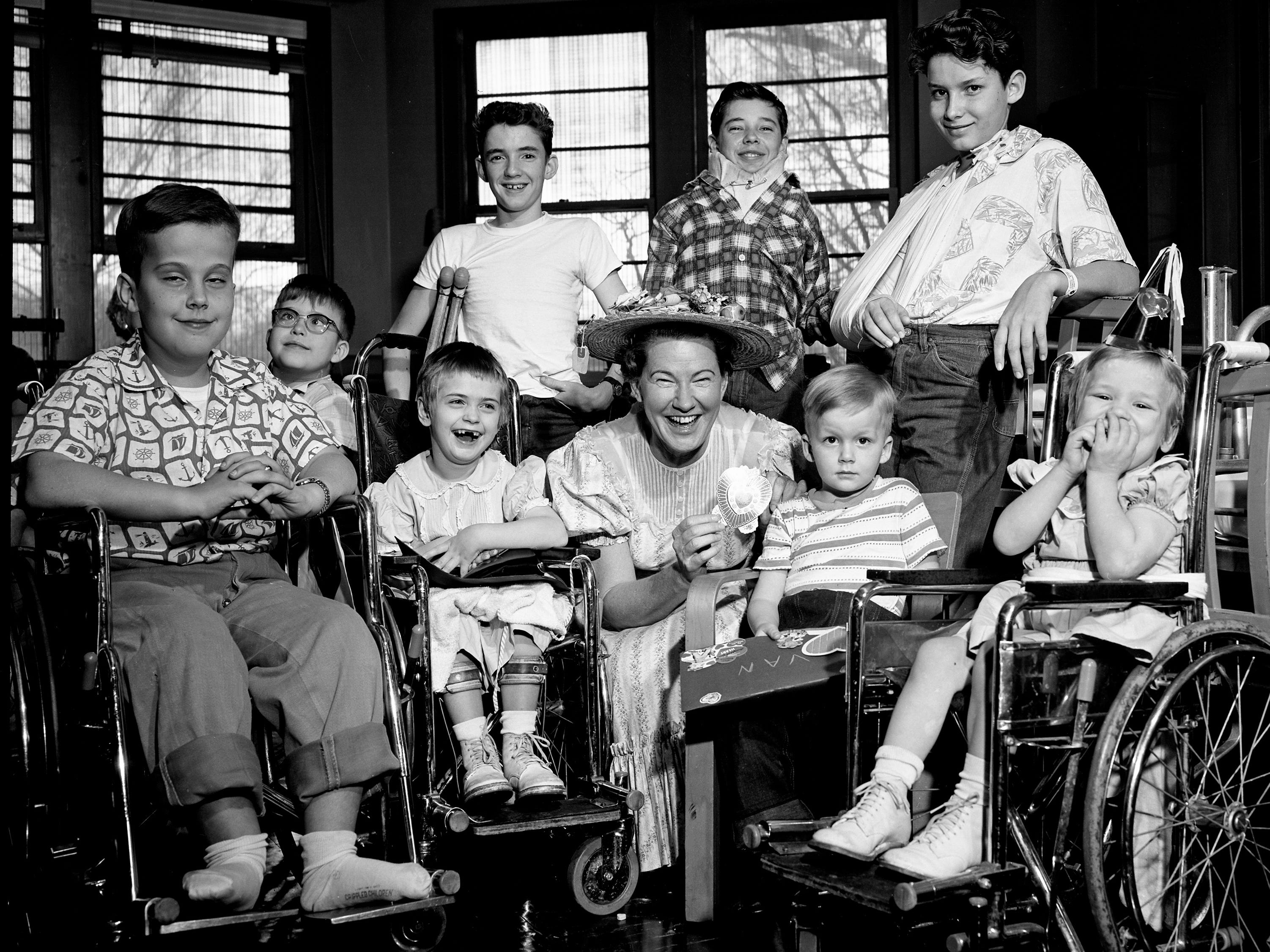 Country music star Minnie Pearl, center, is entertaining the patients during the Valentine party at the Junior League Home for Crippled Children in Nashville on Feb. 14, 1962.