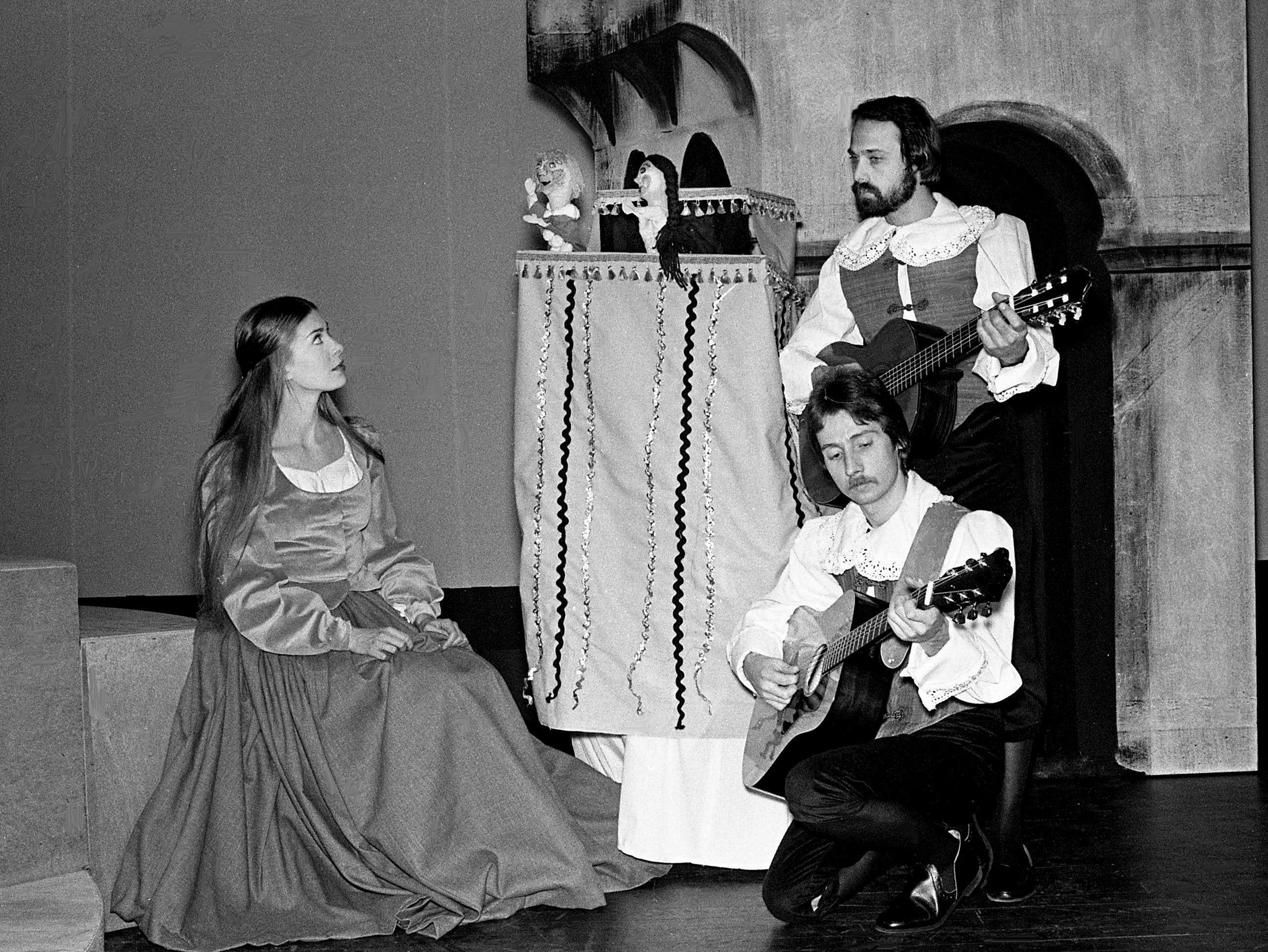"Anne Terease Fox, left, as Cinderella, watches a puppet show as street musicians, played by Charles Trois, top, and Timothy Miller, rehearse Feb. 13, 1979, for the Nashville Academy Theater's new production of the classic ""Cinderella."""