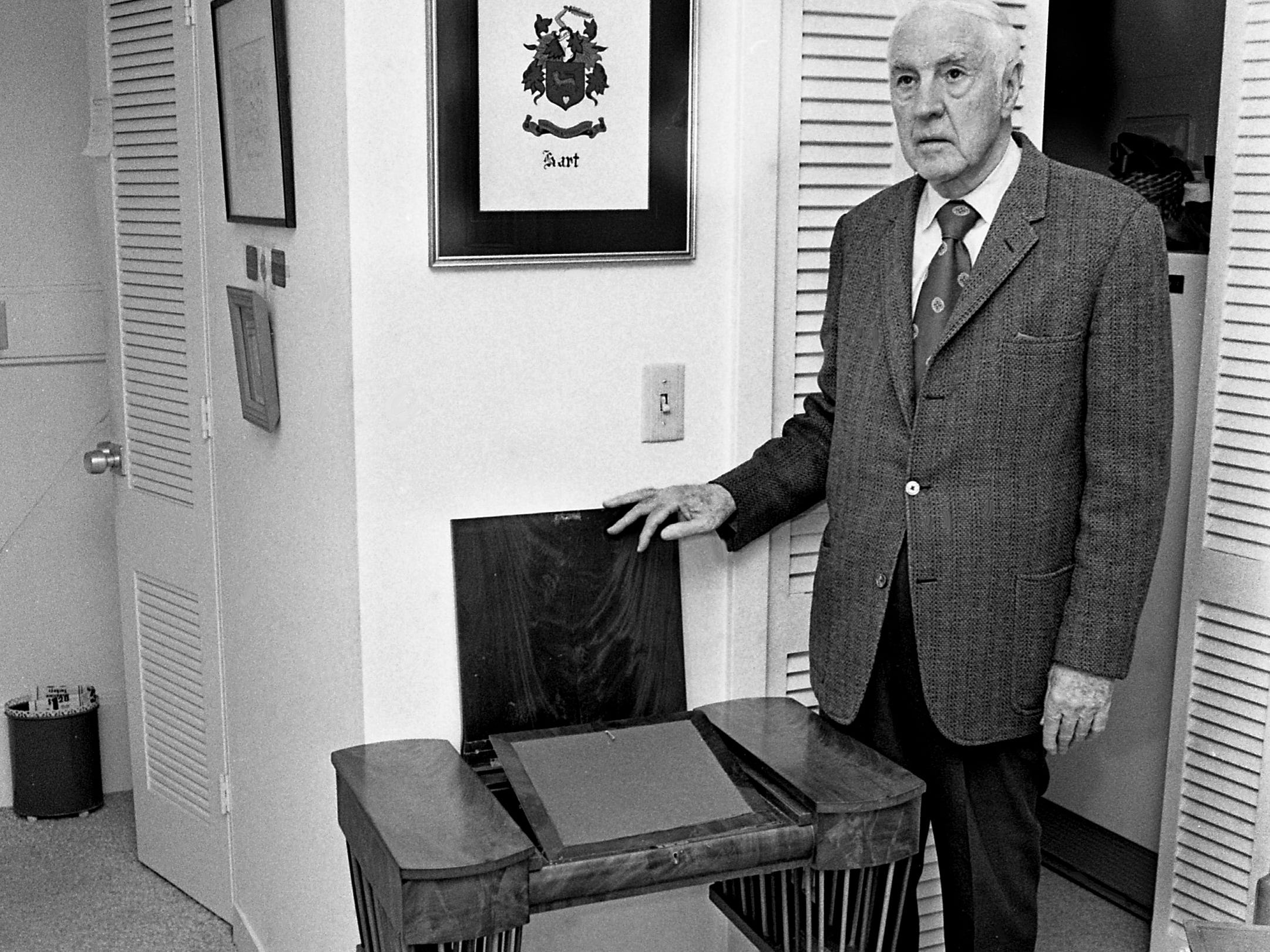 Terry Hart, descendant of the original owner of the Woodlawn, stands beside a small writing desk at the home at 127 Woodmont Blvd. on Feb. 20, 1979. The desk was given by Andrew Jackson to his friend Willoughby Williams, great-grandfather of Hart. Williams was the son-in-law of Capt. John Nichols, who built the house in 1812, and took possession of the house in 1823.