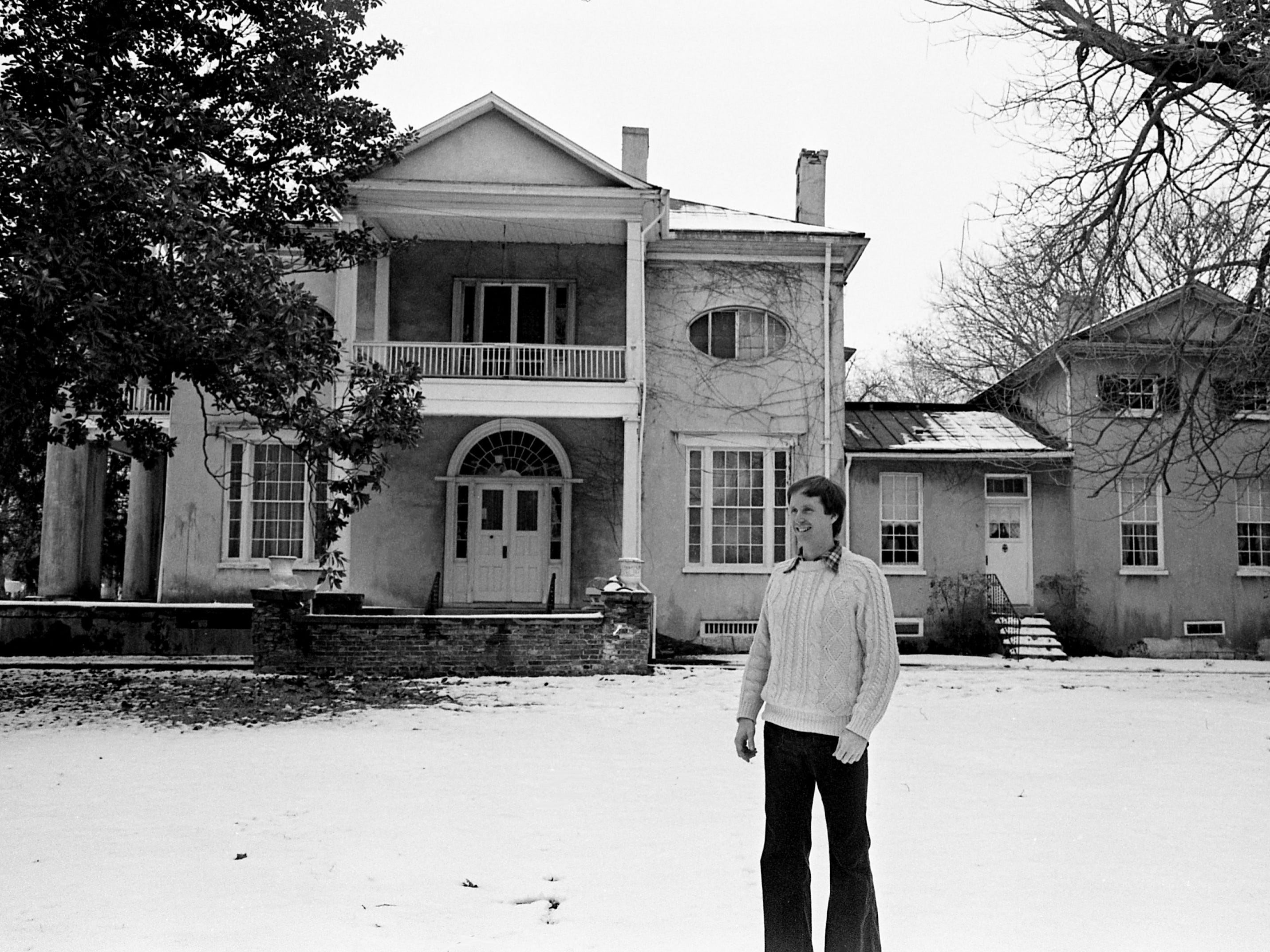 Paul Clements, who is writing on the history of the Woodmont area, stands Feb. 20, 1979, in front of the original entrance of the Woodlawn, which was built by Capt. John Nichols in 1812.
