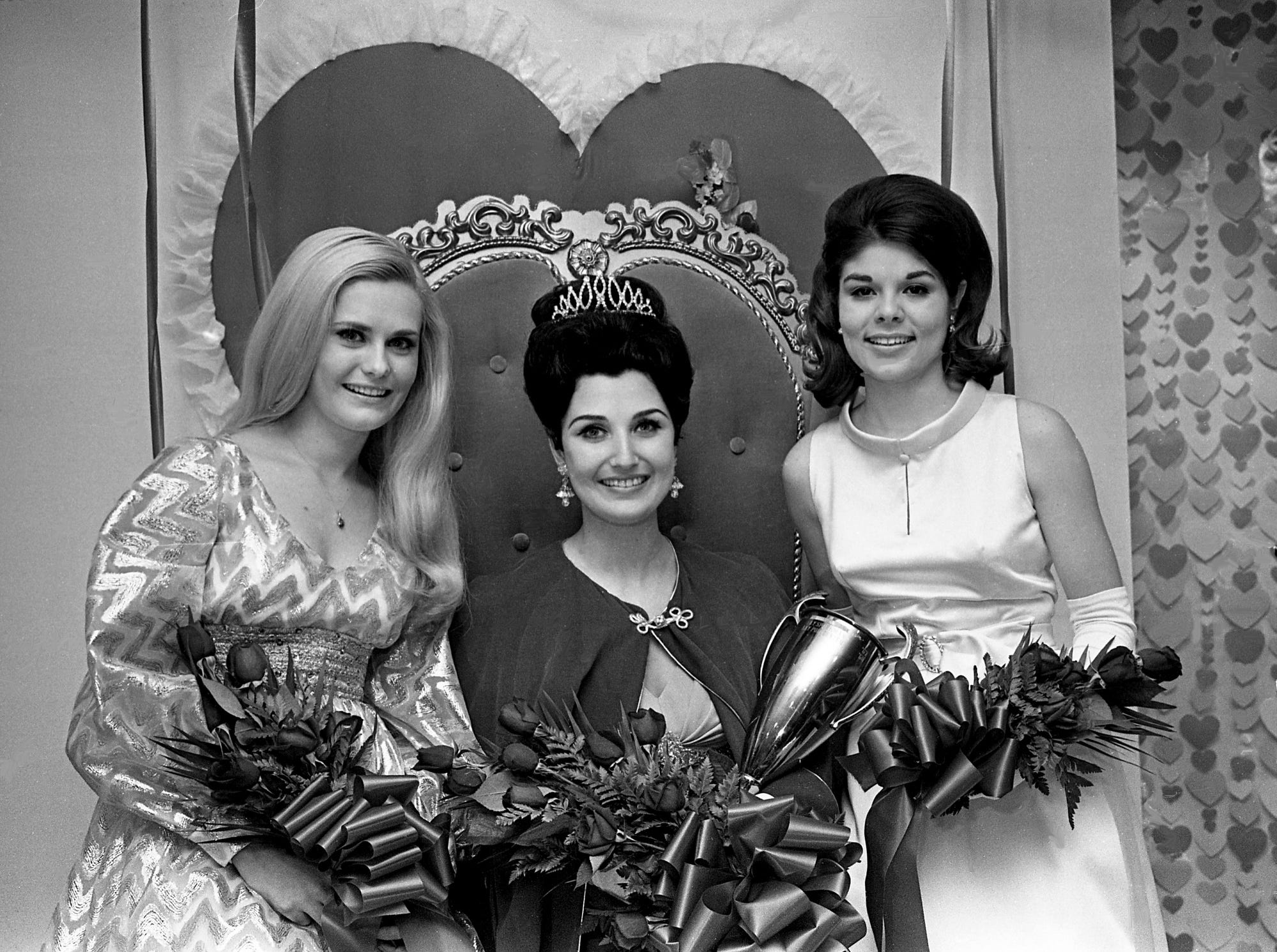 Leslie Anne Hill, center, displays her winning smile after being crowned Queen of Hearts during the pageant at the Cain-Sloan Activity Room on Feb. 7, 1969. She is flanked by first runner-up Jan Williams, left, and second runner-up Pat McKnight.