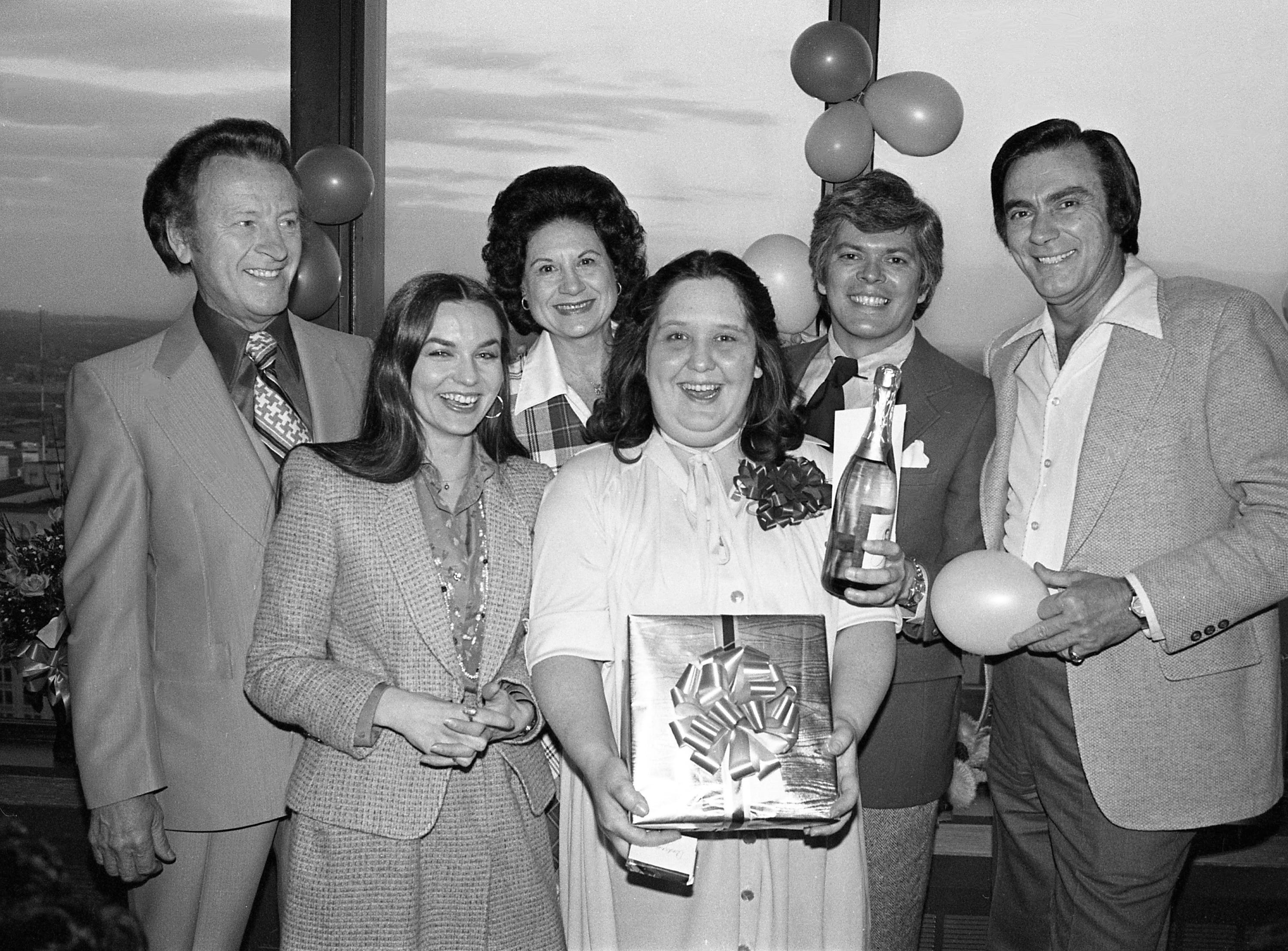 Andrea Smith, third from right, is surprised by a party honoring her 10th anniversary with Top Billing Talent Agency by talent agent Tandy Rice, second from right, at the City Club on Feb. 28, 1979. Among her friends at the celebration are Johnny Wright, left, Crystal Gayle, Kitty Wells and Jim Ed Brown.