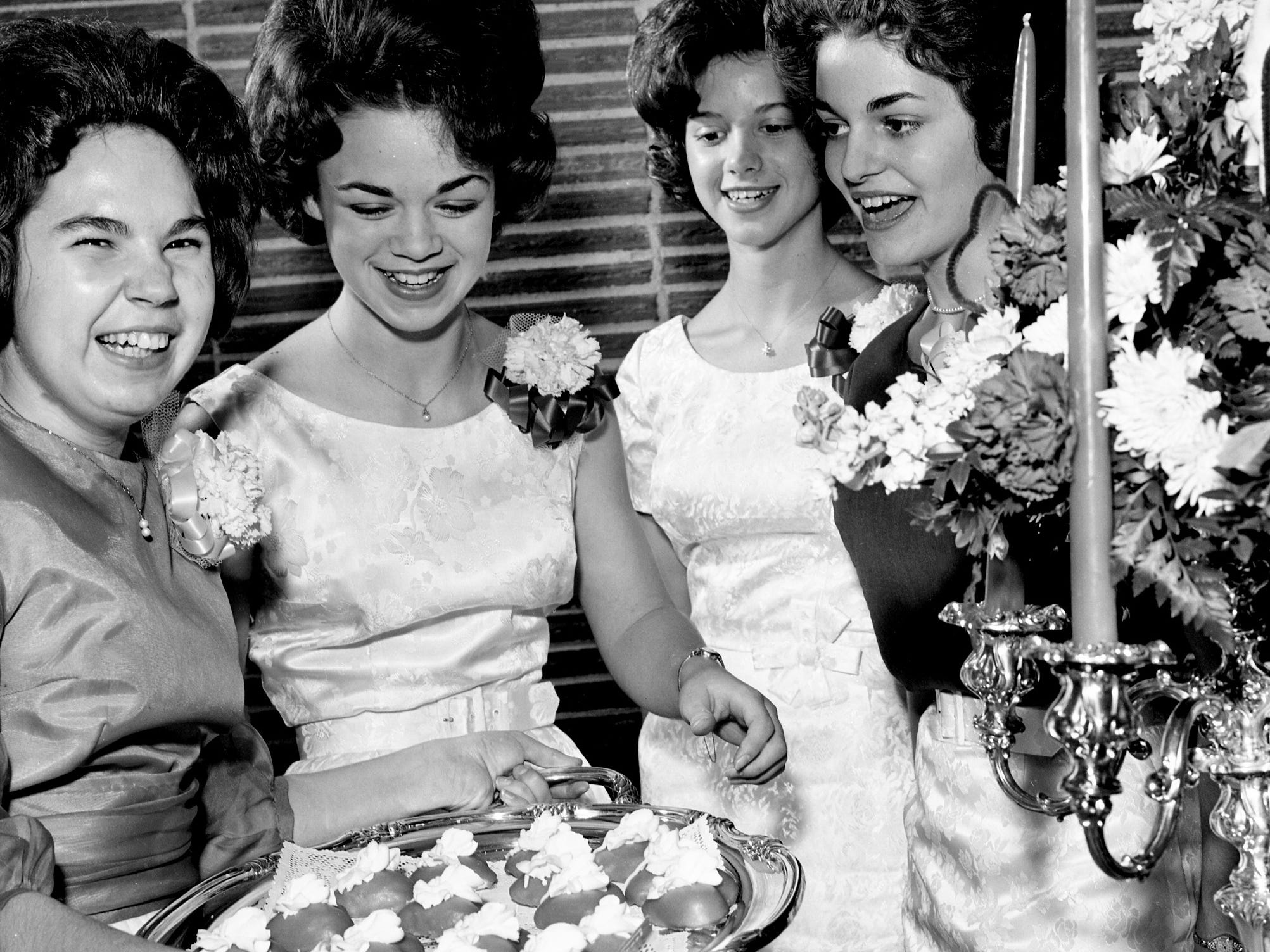 Donnaveene Mayo, left, serving cakes, and Helen Gower, right, entertained at a Valentine punch party at Mayo's home on Granny White Pike Feb. 9, 1963. Shirley Smith, second from left, and Shirley Griggs are guests.