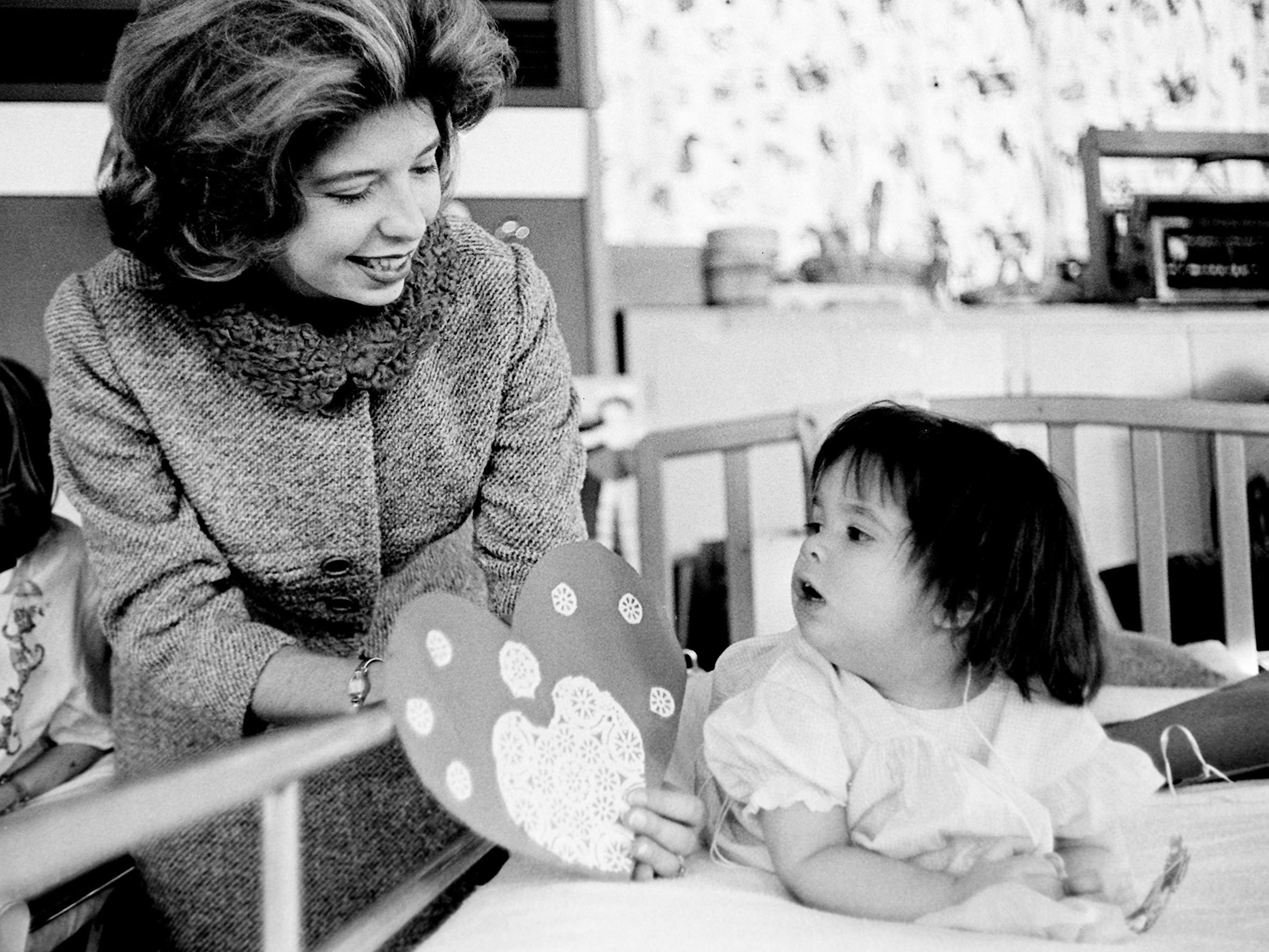 Beth Bentley, right, 20-month-old patient from Gainesboro, admires a frilly Valentine held by Junior League member Mrs. DeBow Casey during a party Feb. 14, 1963, at the Junior League Home for Crippled Children in Nashville.