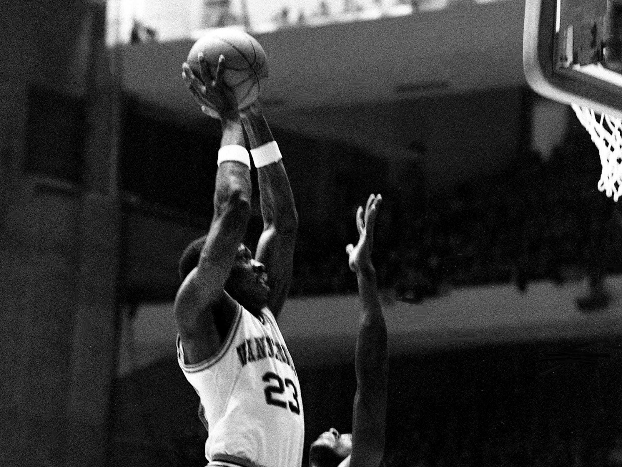 Despite being closely defended by Mississippi State's Wiley Peck, Vanderbilt junior Charles Davis (23) shoots for two of his 16 points in the Commodores' 70-68 victory before a full house of 15,626 fans at Memorial Gym on Feb. 10, 1979.