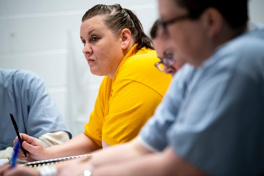 Amelia Stem takes notes during a business communications class which is part of the Lipscomb LIFE program at the Tennessee Prison for Women in Nashville, Tenn., Wednesday, Feb. 6, 2019.