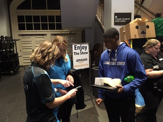 Kevin McHenry, a senior at Tennessee State University, speaks with Amazon recruiters Wednesday at Ryman Auditorium