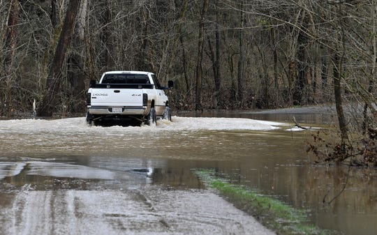 A truck goes through flooding on Pond Creek Road after overnight rains hit Middle Tennessee Thursday, Feb. 7, 2019.