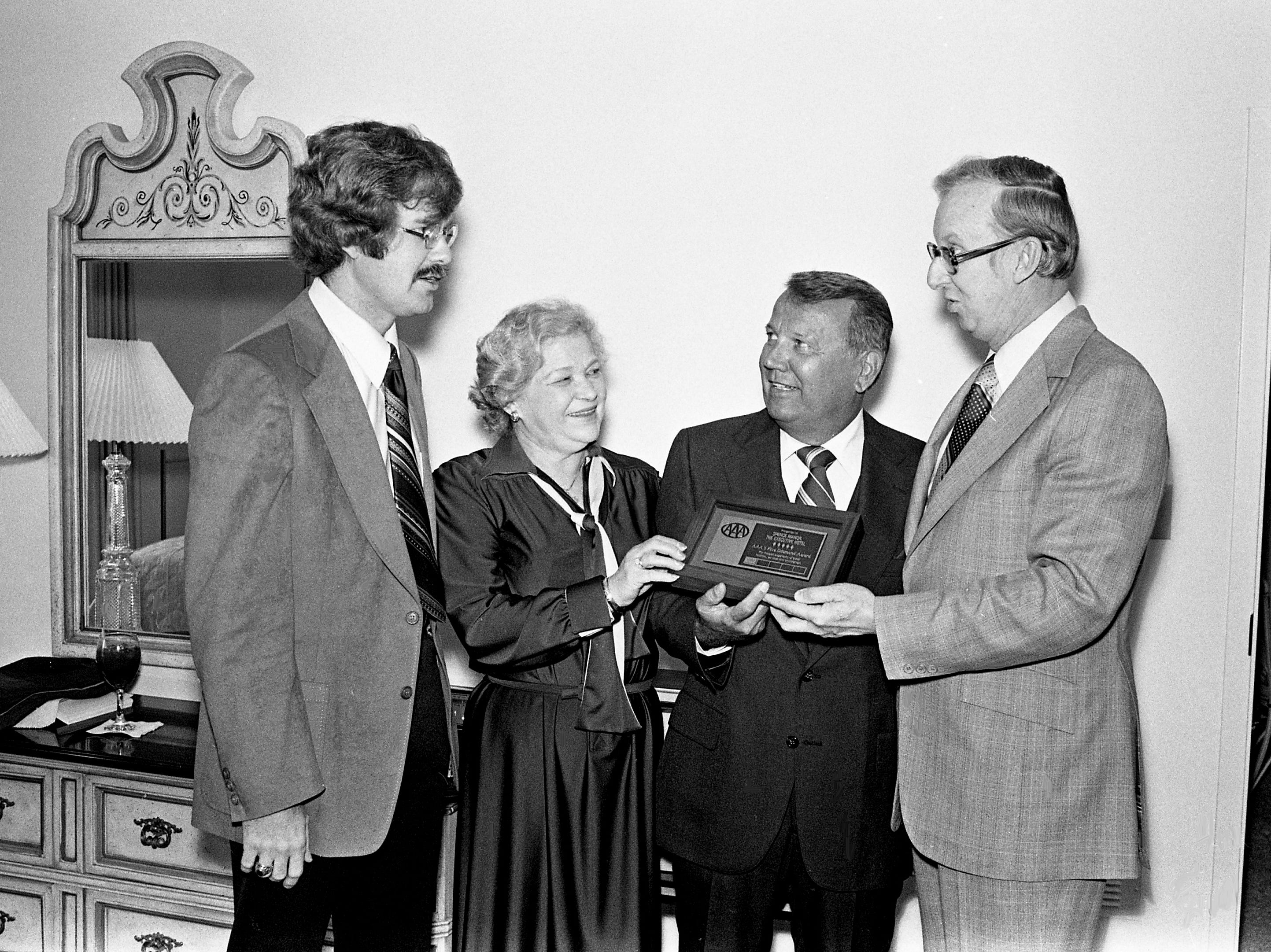 Edna Bloodwoth, general manager of the Spence Manor hotel at 11 Music Square E., and Jack Spence, second from right, president of Motel Systems Inc., receive a plaque denoting Spence Manor's highest overall five-diamond rating by the American Automobile Association on Feb. 7, 1979. Making the presentation are Lynn Schneider, left, of the AAA national travel department and Thomas H. Price, president of the Mid-South Automobile Club, a local AAA affiliate.
