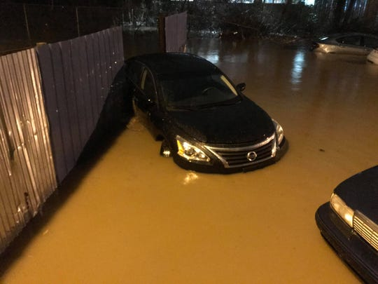 Water surrounds cars at AMS Auto Sales and Repair on Nolensville Road after heavy rains hit Middle Tennessee Wednesday, Feb. 6, 2019, in Nashville, Tenn.