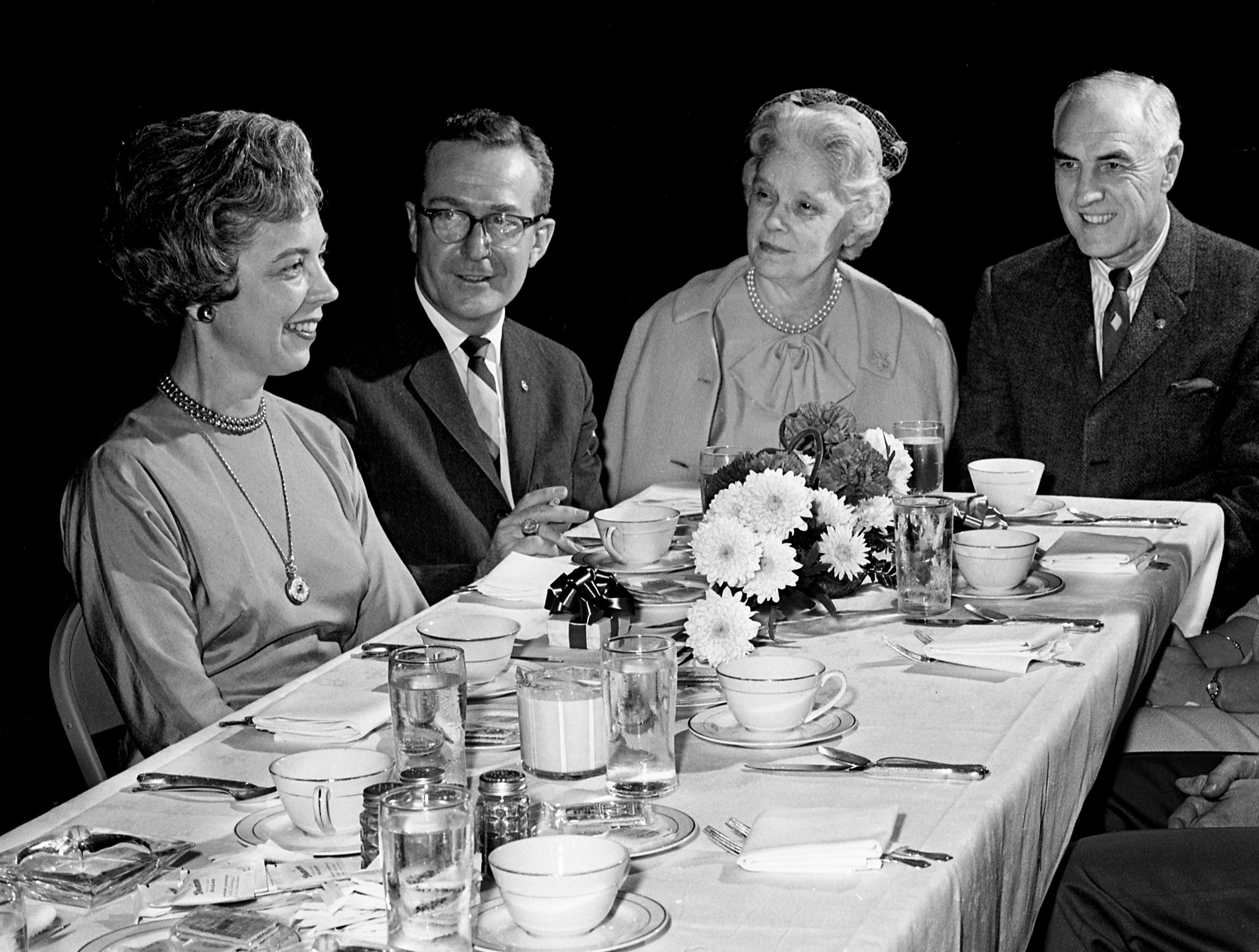 Members of the Downtown Lion's Club are entertaining at a Valentine party at the Top of the Plaza at Belle Meade Plaza honoring their wives Feb. 11, 1965. Two past presidents and their wives enjoying the luncheon are Mrs. and Mr. J. Thomas Dawson, left, and Mrs. and Mr. Terry Hart.