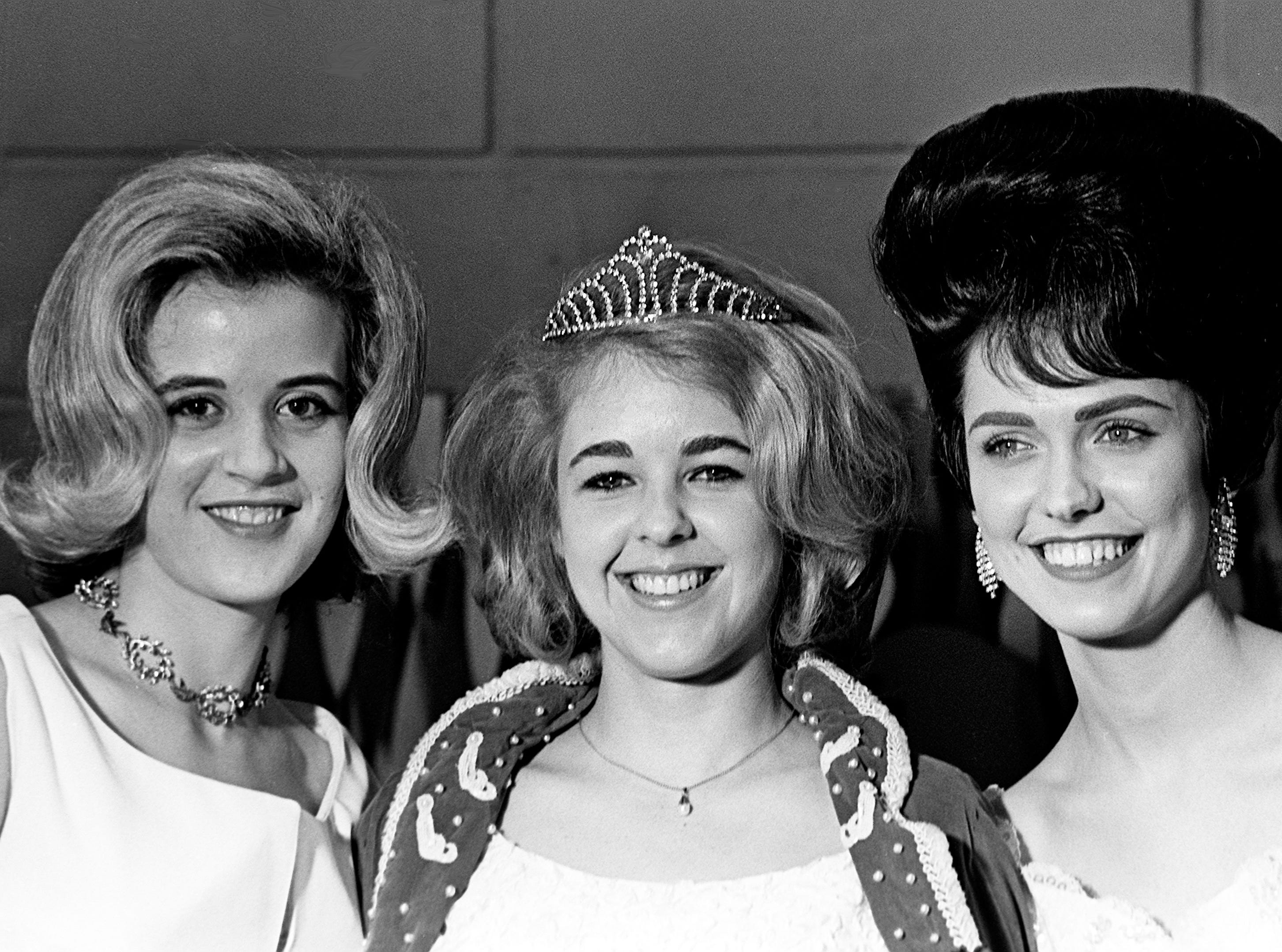 Pam Gardner, center, the 1965 Queen of Hearts, is flanked by runners-up Malinda Rice, left, and Linda Parrish, during the Queen of Hearts Beauty Pageant at the War Memorial Auditorium on Feb. 11, 1965. The upcoming pageant and Heart Fund Ball, which the queen will reign, are sponsored by Gamma Kappa Chapter of Beta Sigma Phi Sorority to benefit the Middle Tennessee Heart Association.