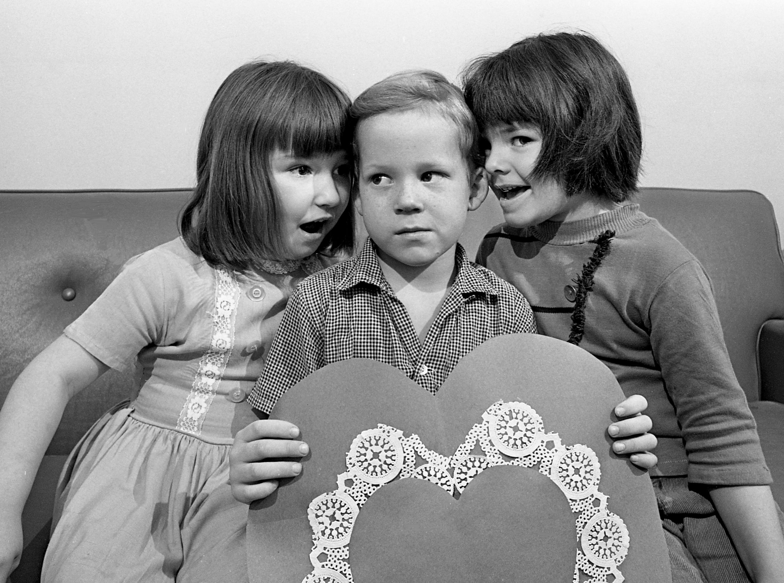 Who'll be his Valentine? The moment of truth nears for Harvey Hammock, 5, as two young ladies woo him with whispered sweet nothings Feb. 10, 1967. They are Nancy Fields and Cynthia Woodard. The youngsters are from McNeilly Day Home, one of five United Givers Fund day care agencies.