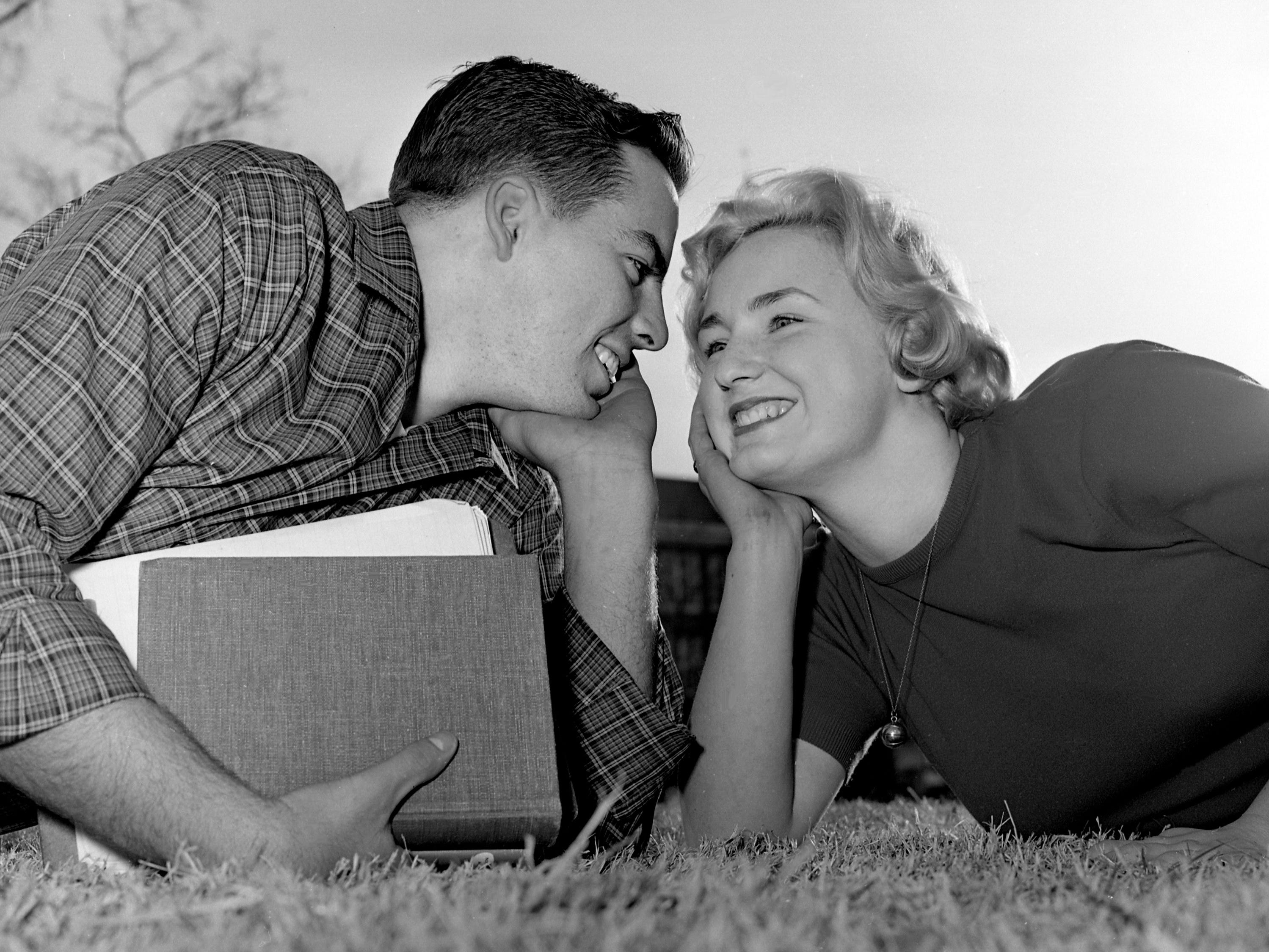 A boy, a girl, a spring February day and Valentine are the winning combination for Eddie Voekel, 18, left, and his steady, June Morton, 18, as the West High School seniors forget books for more romantic musings Feb. 13, 1961.