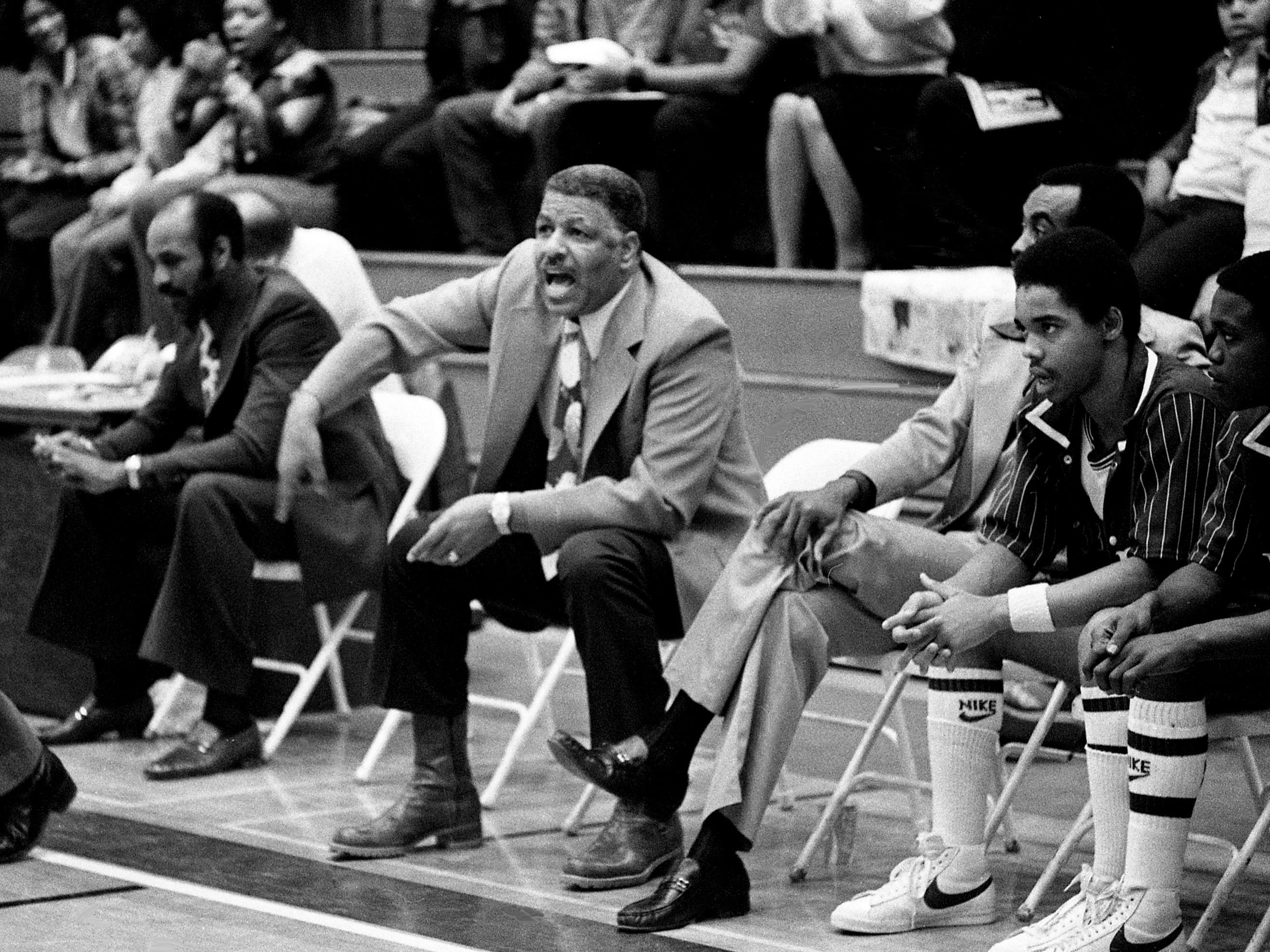 Tennessee State head coach Ed Martin, center, shouts instructions to his players, but it wasn't enough as they fell 84-81 to Alabama State in their season finale at home in Kean's Little Garden on Feb. 24, 1979.