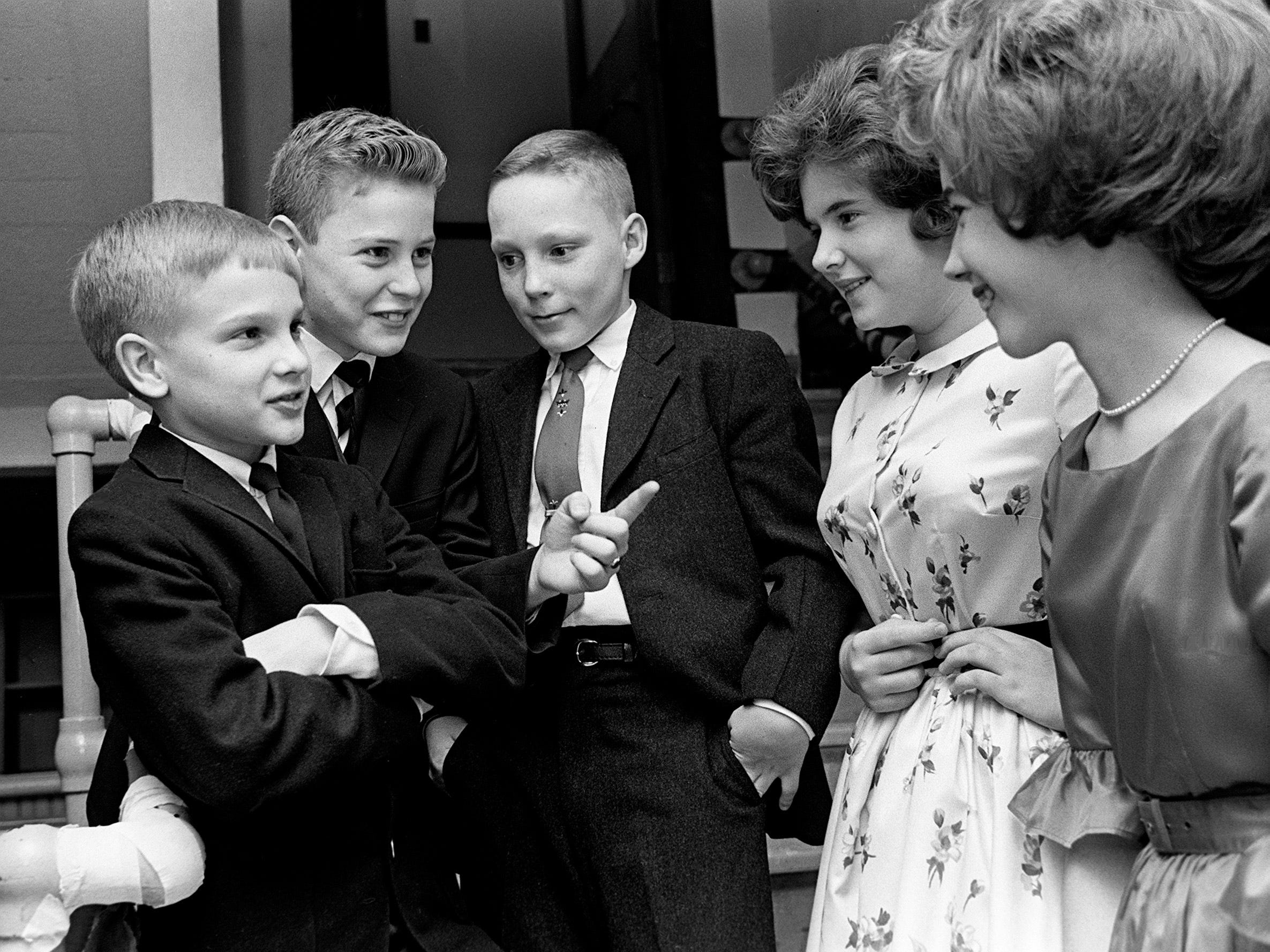 John Hardin, left, Tom Branum and John Billings are looking cool as a couple of girls are looking for a dancing partner in the lunchroom at Montgomery Bell Academy during the seventh and eight graders Valentine party Feb. 15, 1963.
