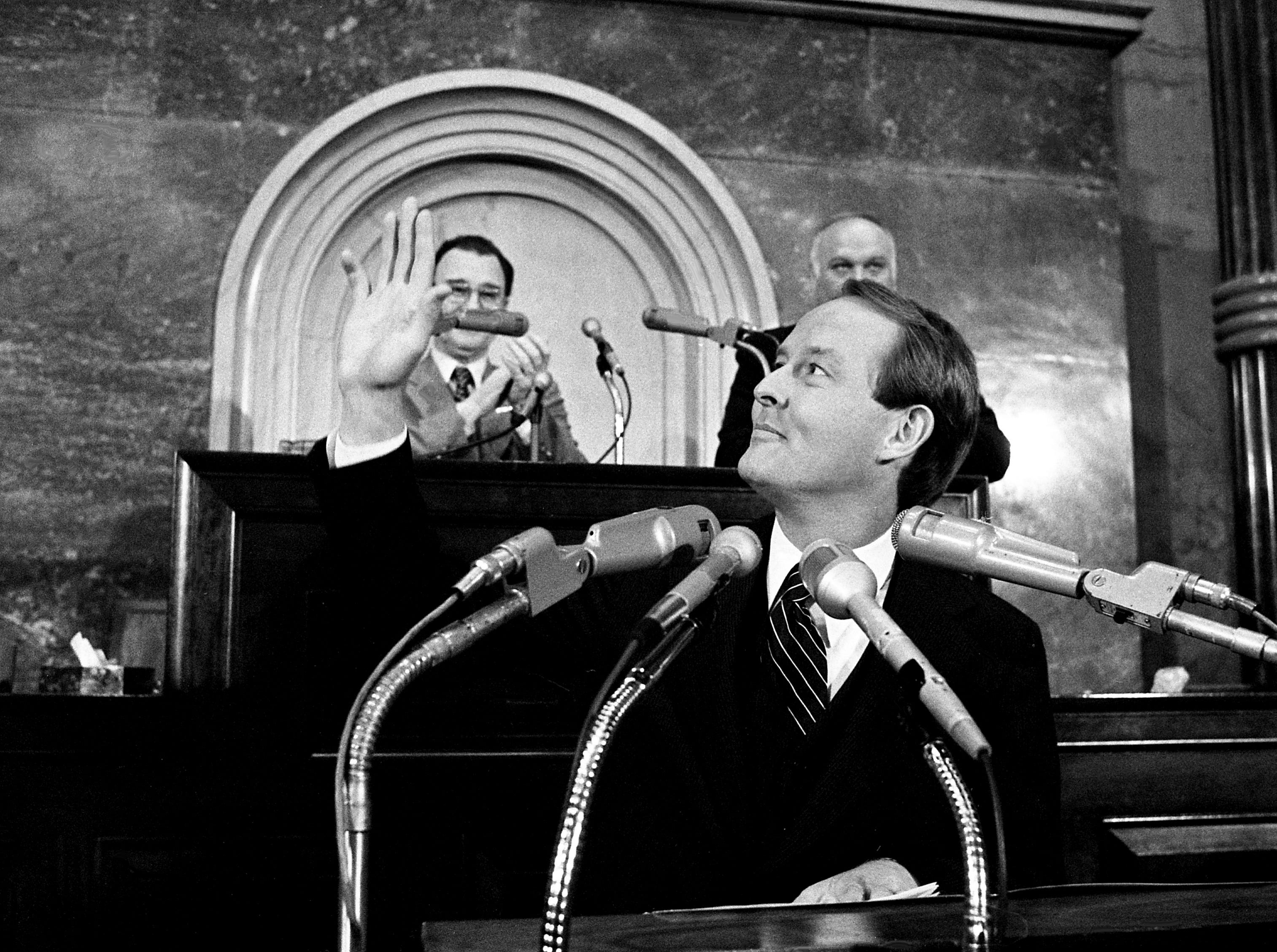 Gov. Lamar Alexander waves to the crowd before his budget address to the joint legislature at the state Capitol on Feb. 28, 1979. Looking on behind him are Lt. Gov. John Wilder and House Speaker Ned McWherter.