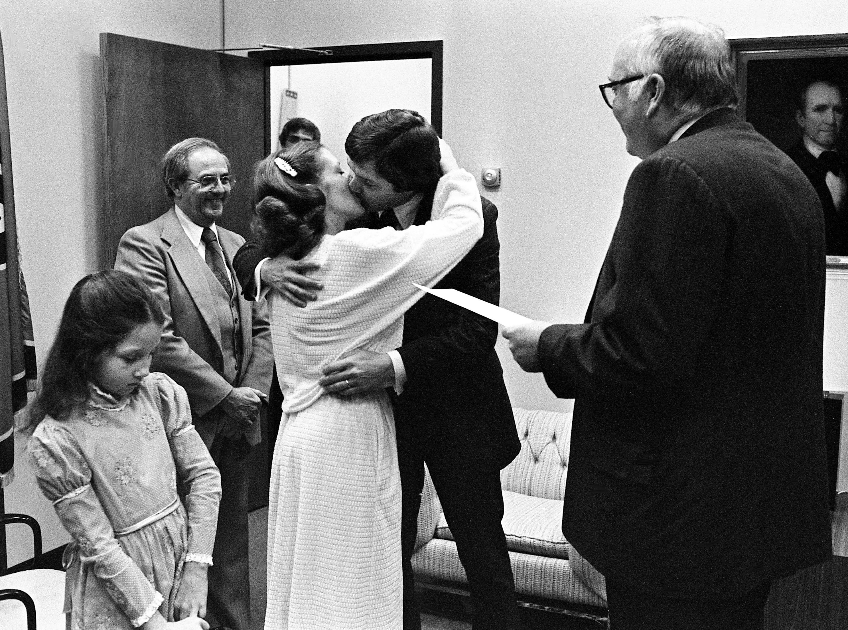 "State Rep. Gene Davidson, center right, D-Springfield, kisses the former Teena D. Webster, of Portland, after House Speaker Ned Ray McWherter, right, pronounced them man and wife at Legislative Plaza on Feb. 27, 1979. The couple were attended by the bride's daughter, Melissa Webster, 9, left, and Rep. John Steinhouer, D-Hendersonville. ""I was more nervous than they were,"" McWherter said."