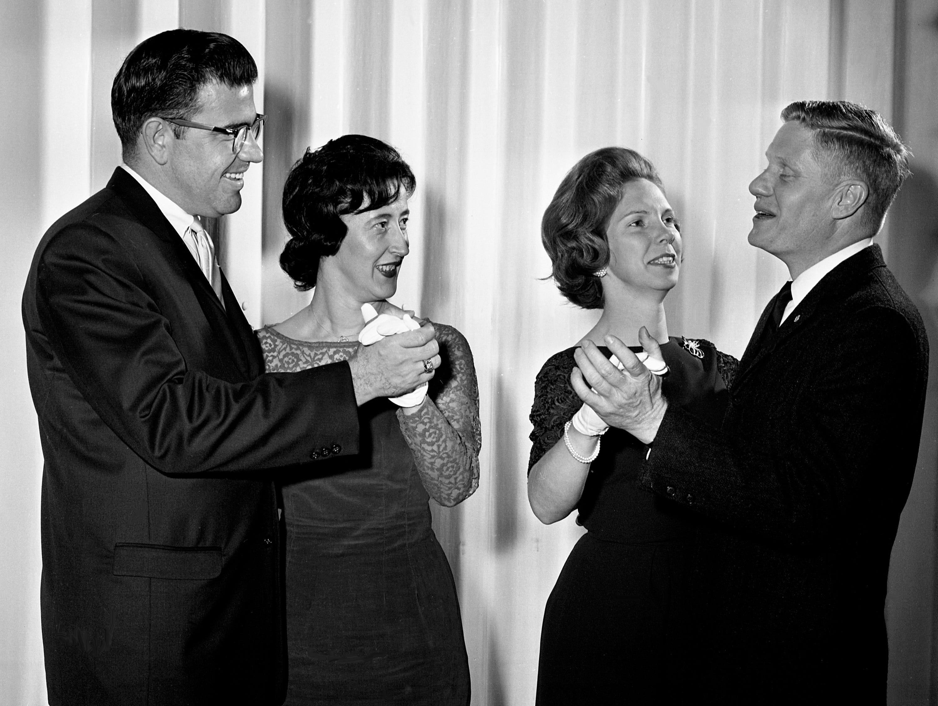 Richland Country Club is the scene of the Lions Club annual Valentine Party on Feb. 13, 1964. Dancing to the music of Hank Corcoran Orchestra are Mr. and Mrs. Rodney Ahles, left, and Mrs. and Mr. Robert E. Cowan Jr. Cowan is president of Lions Club.